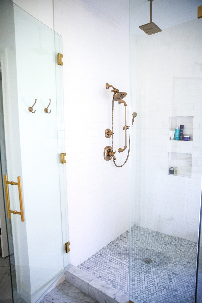 white marble bathroom, pinterest bathroom marble and gold, marble floors bathroom, marble countertops in bathroom, emily gemma bathroom, careers marble bathroom, free standing tub white, free standing out of ground faucet for tub, rob key designs doors, carerra marble and gold fixture bathroom, pinterest bathroom idea, luxury bathrooms pinterest, the sweetest thing blog home bathroom, gold light fixtures for bathroom