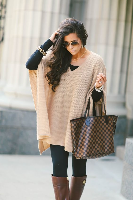 16 Thanksgiving Outfit Ideas featured by top US fashion blogger, Emily Gemma of The Sweetest Thing: cute fall thanksgiving outfitt 2017, cute pinterest outfit poncho and leggings and tory burch boots, emily ann gemma, the sweetest thing blog, all black outfit pinterest, easy cute casual womens outfit fall pinterest tumblr thanksgiving, fashion blogger fall outfits pinterest tumblr, louis vuitton Neverfull Damier Ebene MM outfit pinterest, cute outfits fall tory burch riding boots