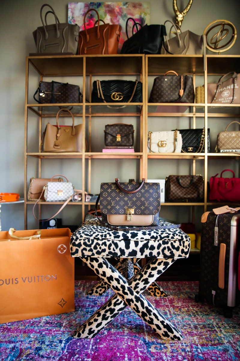 Louis Vuitton Marignan by popular US fashion blog, The Sweetest Thing: image of the Louis Vuitton Marignan messenger bag on a leopard print bench.