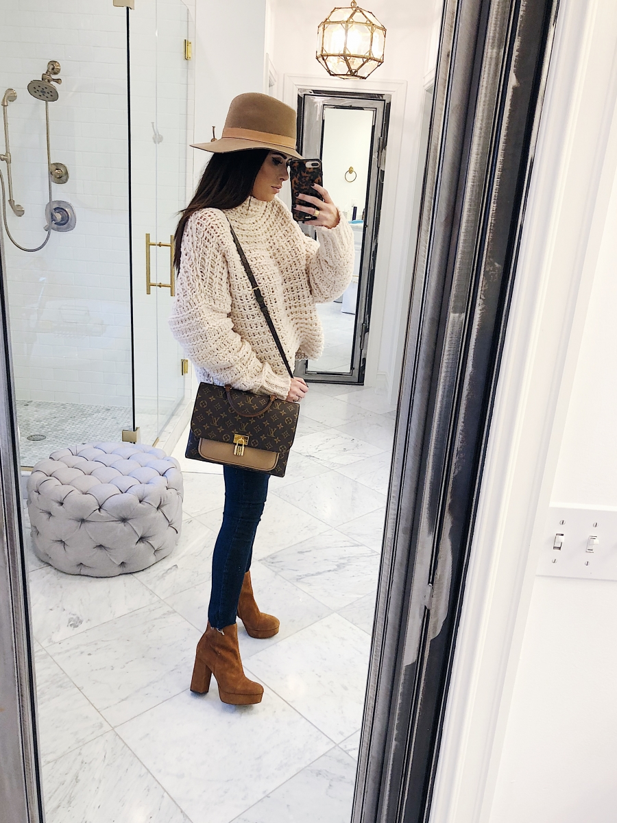 Louis Vuitton Marignan by popular US fashion blog, The Sweetest Thing: image of a woman wearing a Free People sweater, Free People Reagan Button Front Jean, ShopBop Sam Edelman Azra Platform Booties, Louis Vuitton Marignan and a Janessa Leone hat.