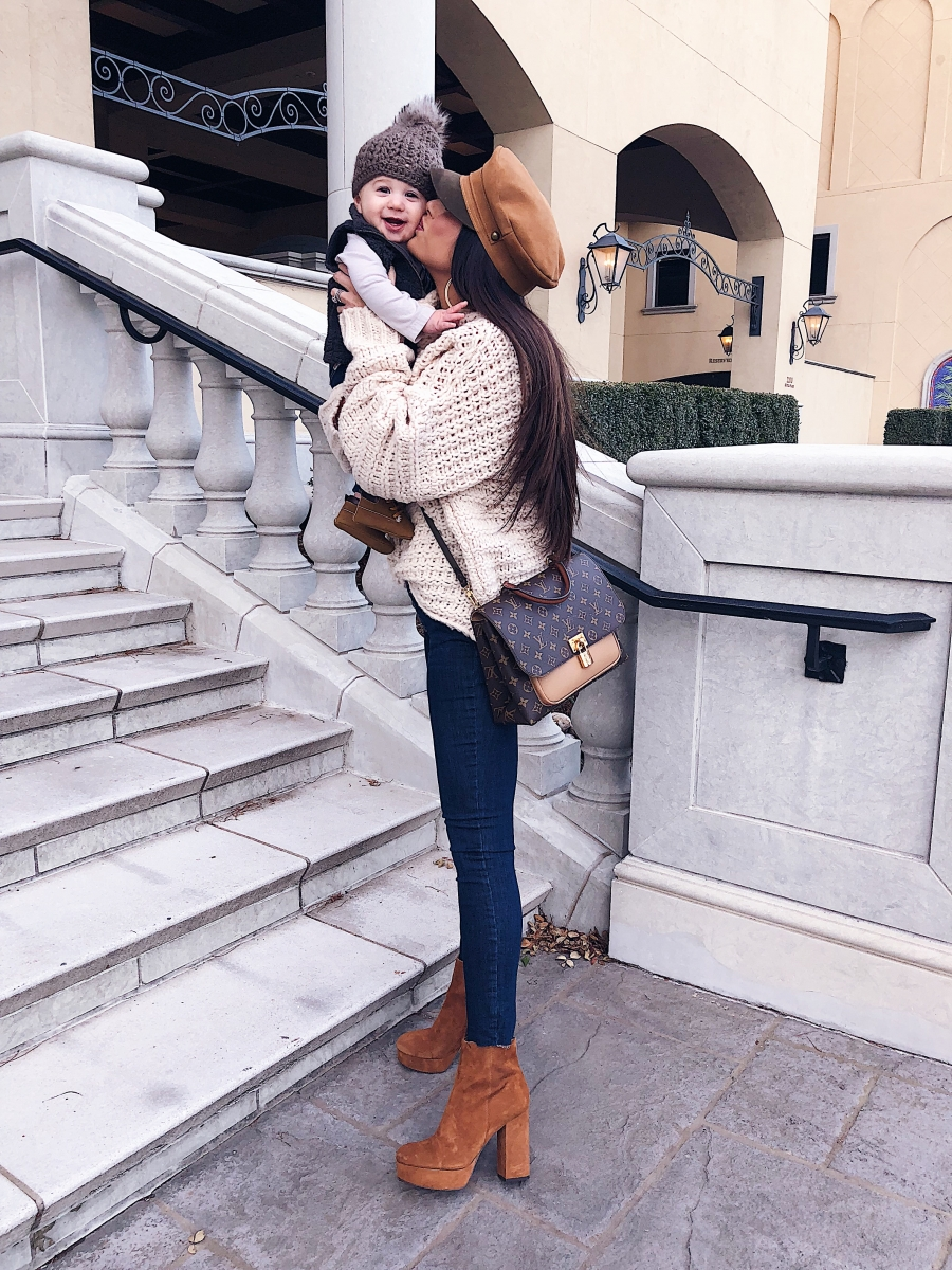 Louis Vuitton Marignan by popular US fashion blog, The Sweetest Thing: image of a woman wearing a Free People sweater, Free People Reagan Button Front Jean, ShopBop Sam Edelman Azra Platform Booties, Louis Vuitton Marignan.