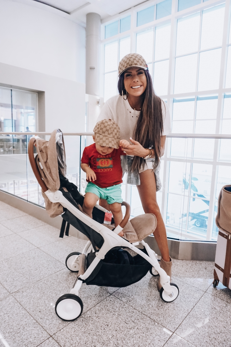 cute airport travel fashion outfit fall 2018, emily gemma travel style, stylish cute casual travel outfit idea 2018, XL chanel bag airline tote gold, baby sing travel stroller reivew