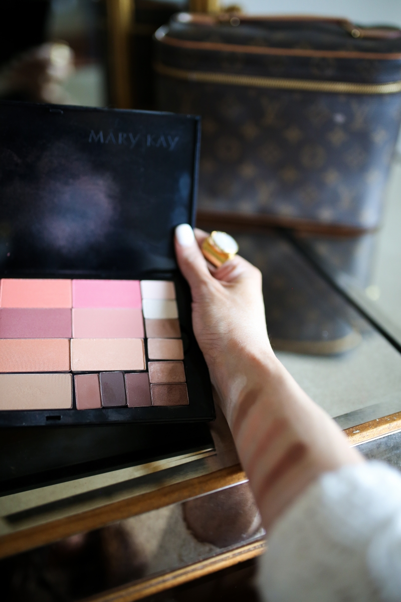 Mary Kay Reviews by popular US beauty blog, The Sweetest Thing: image of a woman holding a Mary Kay makeup pallet.