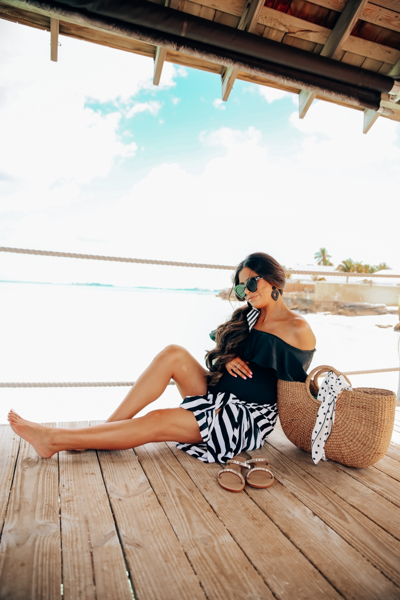 one piece black swimsuit off the shoulder with ruffle, sandals bahamas, meghan markle black sunglasses, emily gemma, one piece maternity swimsuit, pregnancy fashion spring and summer, the sweetest thing blog, meghan marble black le spec sunglasses,