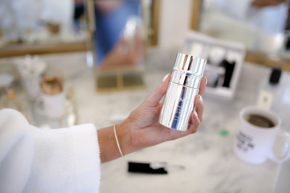 Elemis Pro Collagen Skin Care Line by Popular US beauty blog, The Sweetest Thing: image of a woman holding an Elemis Pro Collagen skin care product.