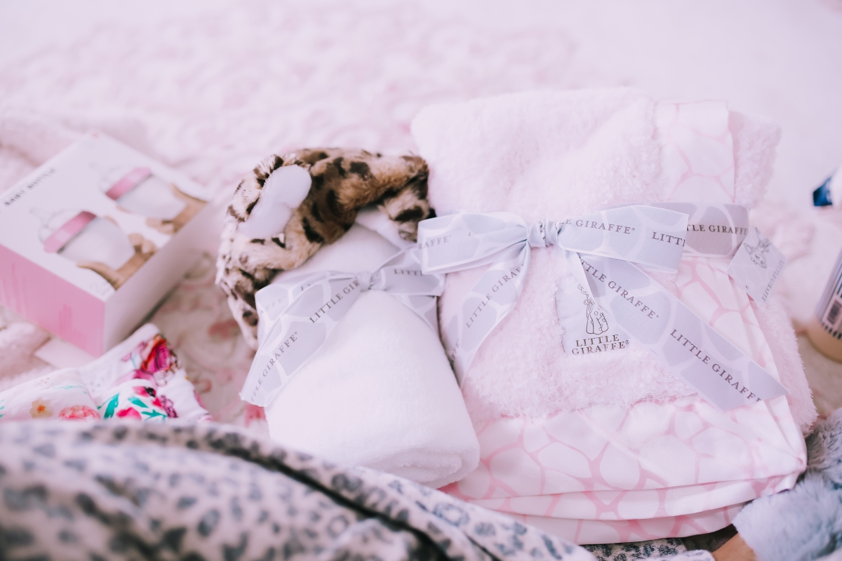 Emily Ann Gemma of The Sweetest Thing Blog in baby girl nursery. Favorite must have baby products.