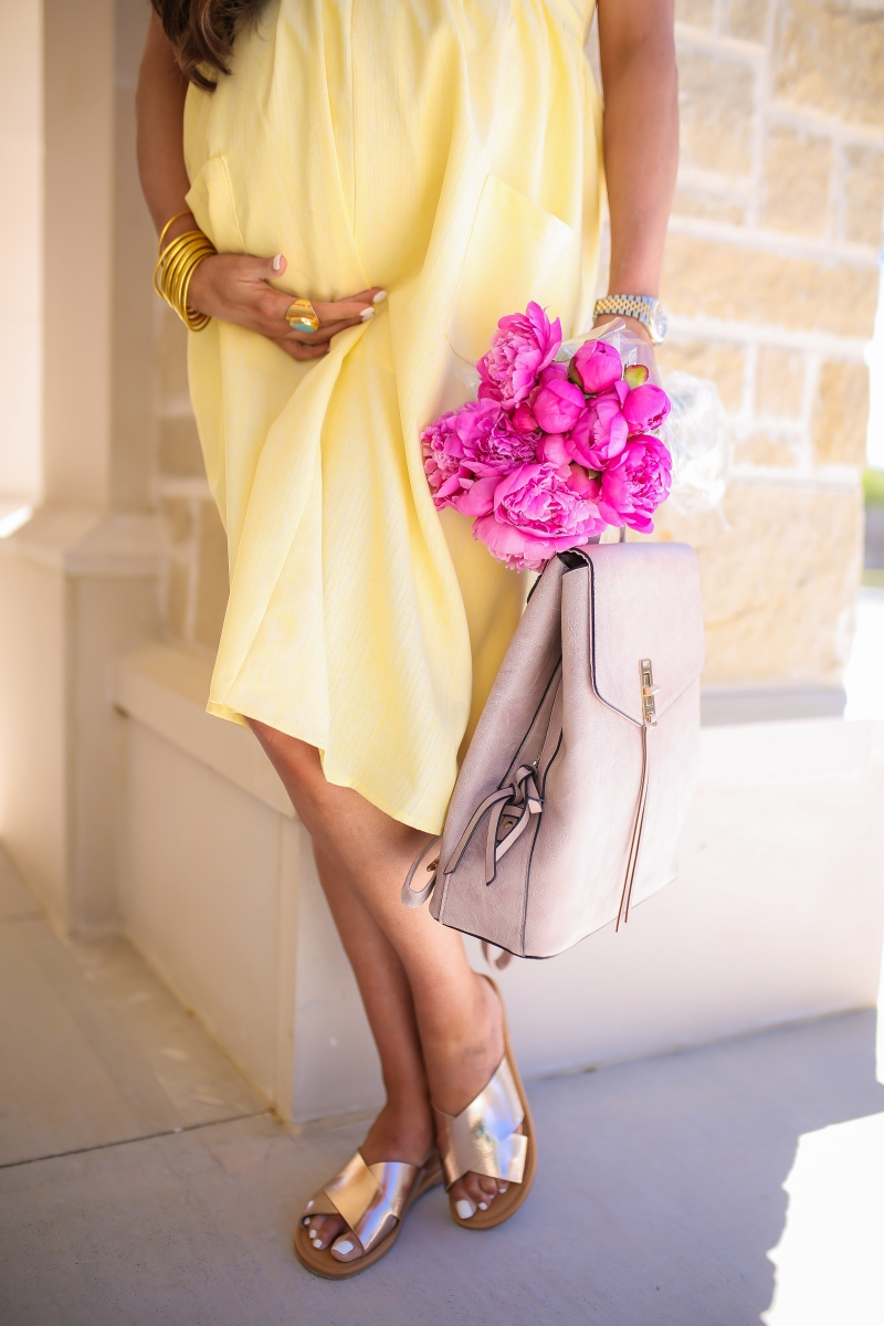 Emily Ann Gemma of The Sweetest Thing blog. Favorite spring outfit staples from Walmart. Yellow dress and metallic sandals.