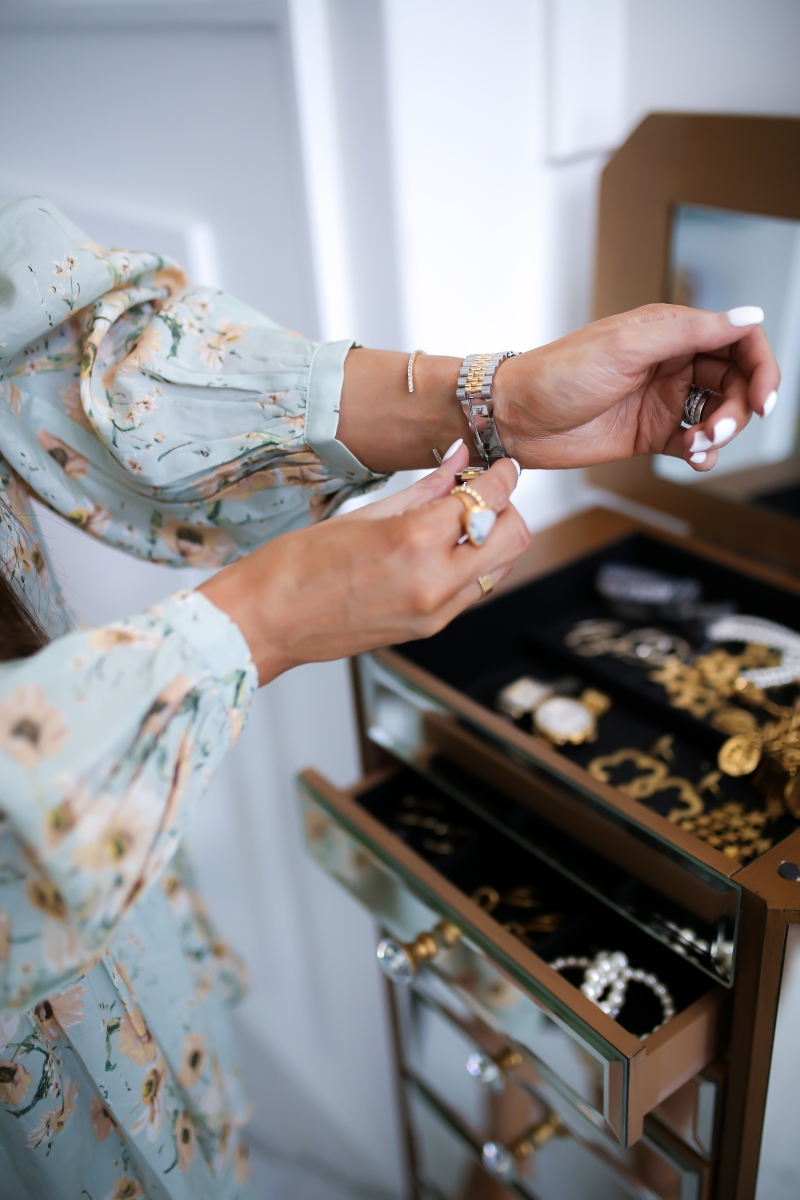 Emily Ann Gemma of The Sweetest Thing blog on purchasing luxury watches, like Rolex, from eBay. Floral dress, headband, and gold jewelry.