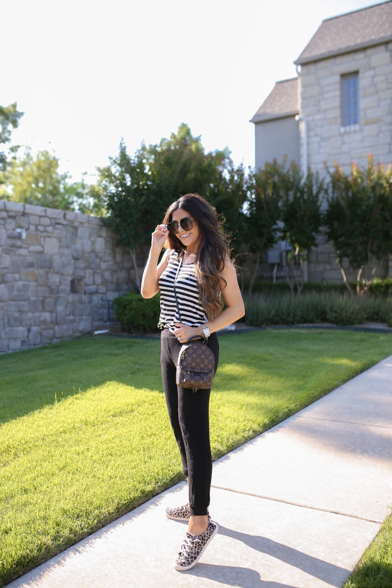 Emily Ann Gemma of The Sweetest Thing blog shares an affordable, Everyday Outfit Under $100 from Walmart. Louis Vuitton backpack, leopard shoes, striped tank, and black pants.