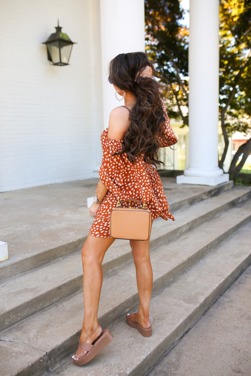 Emily Ann Gemma of The Sweetest Thing Blog's favorite summer dress for under $30. Orange and white polka dot dress, brown wedge heels, deisgner purse.