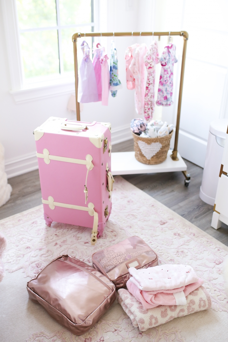 Emily Ann Gemma of The Sweetest Thing shares her Must-Haves For Travel Packing For The Family. Packing for baby and toddler.