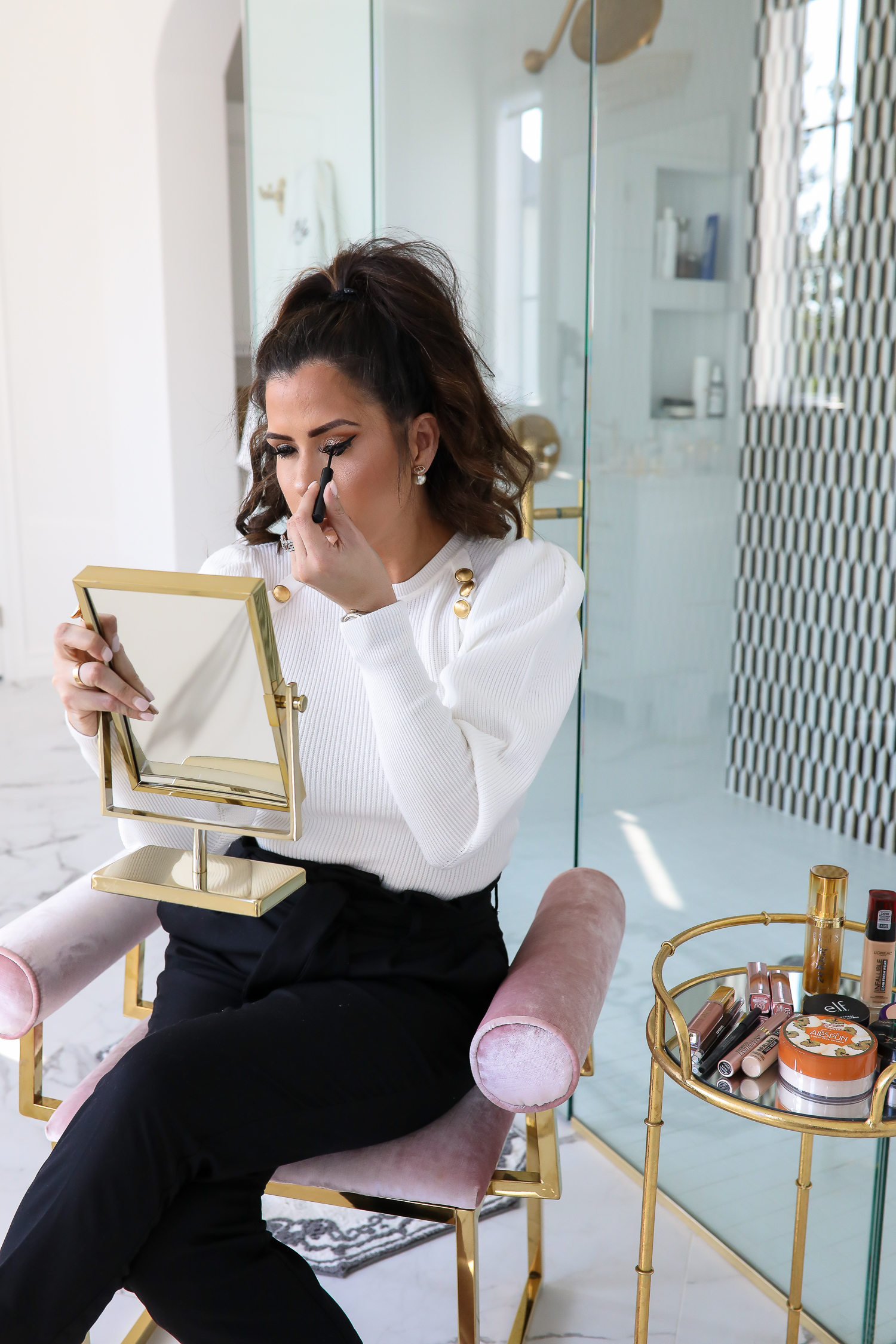 best drug store makeup fall 2019, popular beauty bloggers 2019, best drugstore makeup 2019, emily ann gemma-2 | Best Drugstore Makeup by popular US beauty blog, The Sweetest Thing: image of a woman applying liquid eyeliner.
