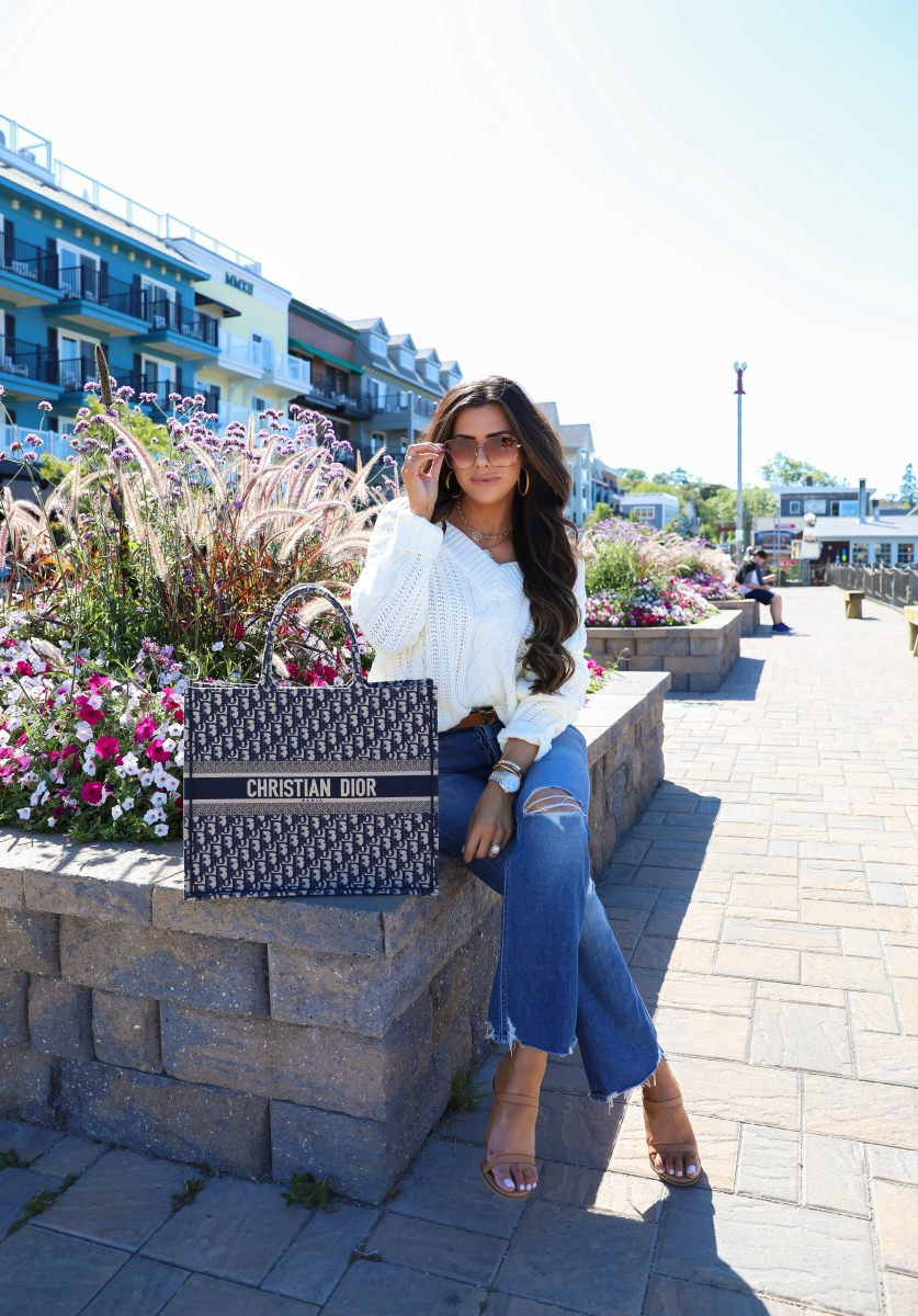 fall fashion pinterest 2019, Dior Book Tote Bag oblique navy, Bar Harbor Maine, emily gemma, Fall Fashion trends 2019, gucci 60mm sunglasses, Mother Tripper denim, Red dress boutique-2 | Off the Shoulder Sweater by popular US fashion blog, The Sweetest Thing: image of a woman outside wearing a Red Dress off the shoulder sweater, Revolve The Tripper MOTHER jeans, Nordstrom Amina Sandal ALIAS MAE, The Styled Collection necklaces, Louis Vuitton belt, Cartier bracelets, Rolex watch, Large Chunky Hoop Earrings ARGENTO VIVO, Nordstrom 60mm Gradient Square Sunglasses GUCCI, and holding a Louis Vuitton bag.