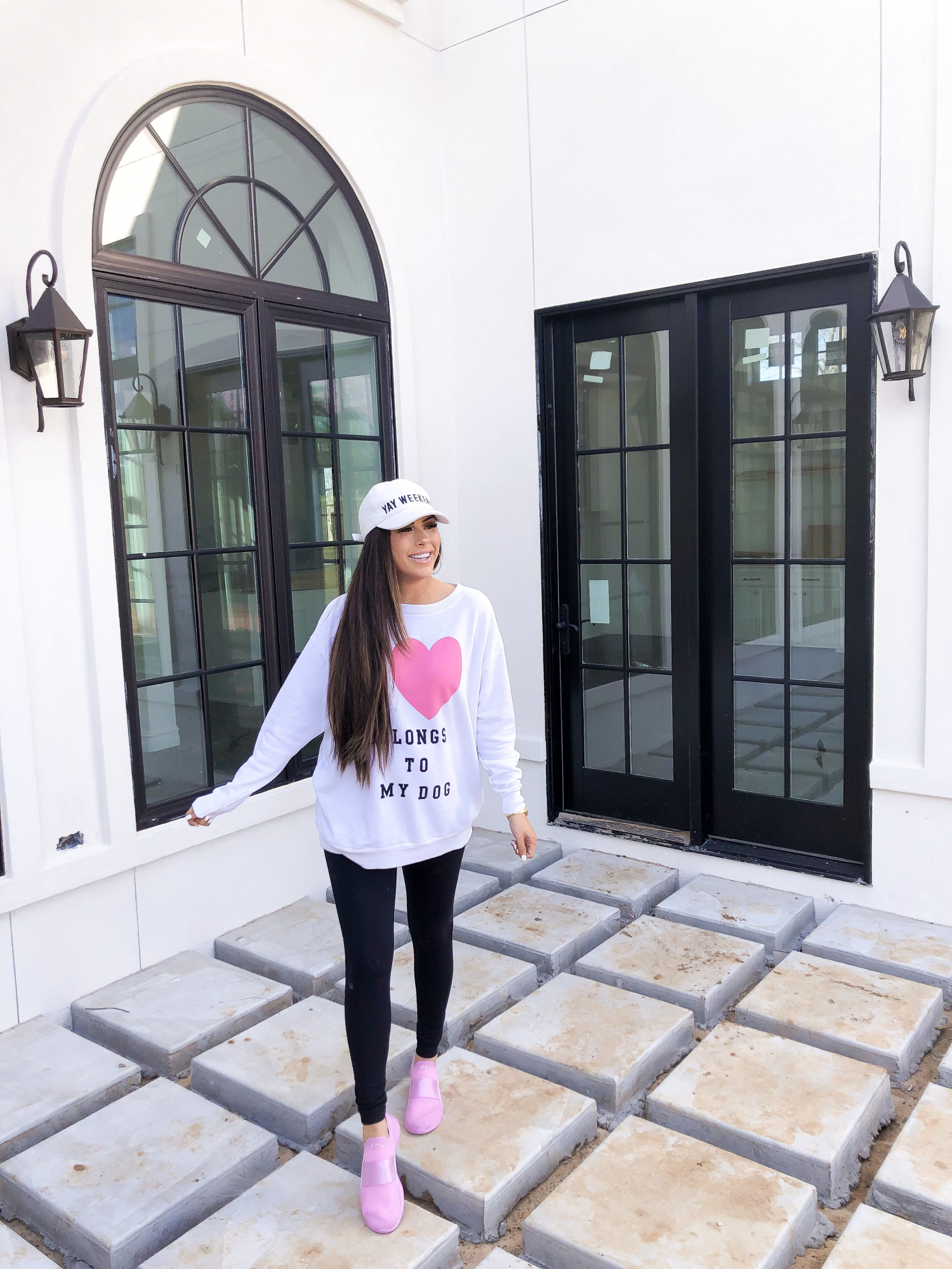 pink APL tennis shoes breast cancer awareness, pavers turf concrete, wildfox oversized sweatshirts, shopbop sale fall 2019, emily ann gemma | Major ShopBop Sale Alert‼️[25% Off My Most Popular Outfits!] by popular Oklahoma fashion blog, The Sweetest Thing: image of a woman wearing ShopBop wildfox sweatshirt and apl sneakers.