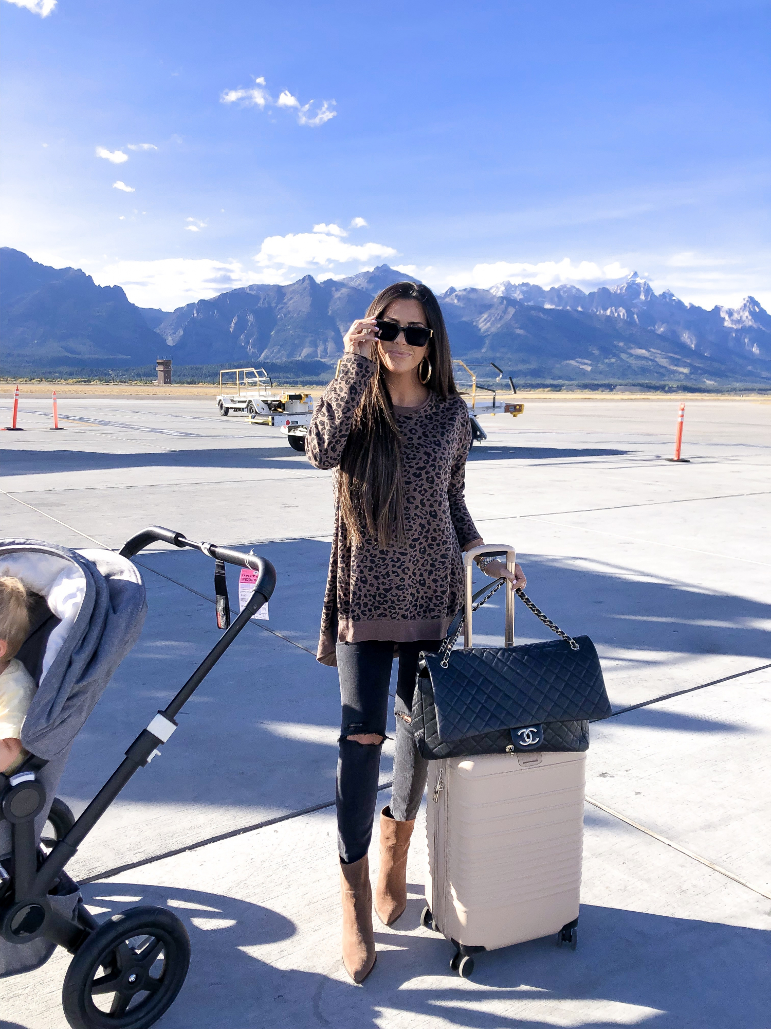 cute fall fashion airport travel outfit idea, emily gemma, chanel XXL airline tote, louis vuitton millionaire sunglasses | ShopBop Sale by popular US fashion blog, The Sweetest Thing: image of a woman wearing a ShopBop Z Supply Leopard Weekender Sweatshirt.