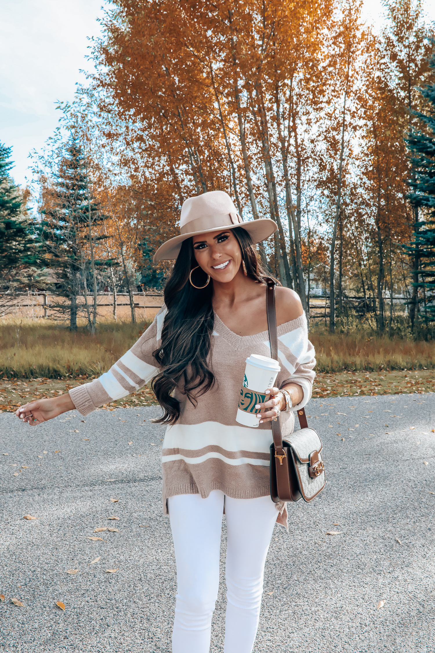 Rag and Bone White Jeans style for Fall by top US fashion blog, The Sweetest Thing: image of a woman wearing Rag and Bone white denim jeans, a Red Dress Boutique off the shoulder striped sweater, Gianni Bini boots, Gucci 1955 shoulder bag, Brixton Panama hat, Rolex watch, Cartier bracelets, Argento Vivo earrings, and a Free People ring | fall fashion outfits pinterest 2019, gucci vintage 1955 bag, fall outfits white denim, red dress boutique sweater, brixton hats-5