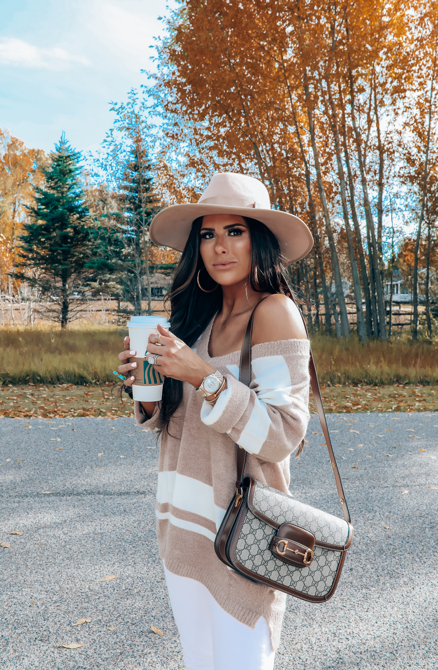 Rag and Bone White Jeans style for Fall by top US fashion blog, The Sweetest Thing: image of a woman wearing Rag and Bone white denim jeans, a Red Dress Boutique off the shoulder striped sweater, Gianni Bini boots, Gucci 1955 shoulder bag, Brixton Panama hat, Rolex watch, Cartier bracelets, Argento Vivo earrings, and a Free People ring | gucci 1055 horsebit bag, fall fashion 2019 pinterest, emily ann gemma