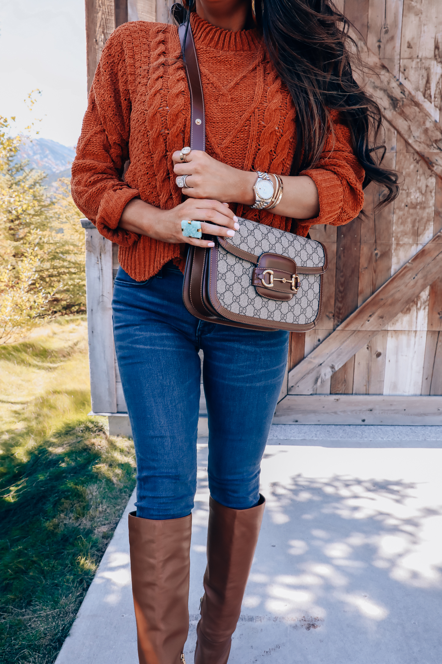 Fall fashion outfit featured by top US fashion blog, The Sweetest Thing: image of a woman wearing a BlankNYC rust sweater, Express denim leggings, Sam Edelman boots, Gucci 1955 shoulder bag, Cartie bracelets, Argento Vivo earrings, Gucci sunglasses and a Free People ring.| fall fashion outfits pinterest 2019, gucci vintage 1955 fall, emily ann gemma, sam edelman brown leather boots_-2