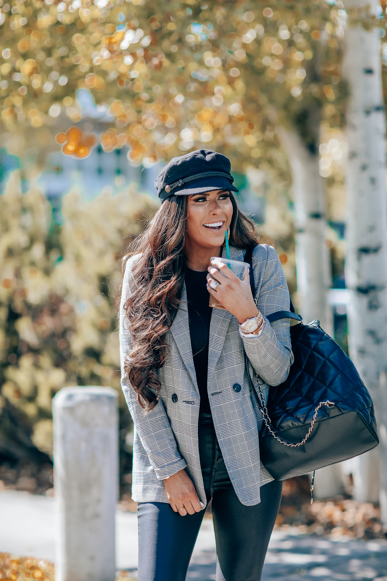 Oversized plaid blazer styled for Fall by top US fashion blog, The Sweetest Thing: image of a woman wearing an Aqua oversized plaid blazer, Splendid long sleeve top, BlankNYC vegan leggings, Marc Fisher booties, Chanel backpack, Baker boy cap, a Rolex watch, Argento Vivo earrings, and Cartier bracelets | fall fashion outfits pinterest 2019, plaid blazer outfit fall, leather pants outfit fall, how to style a plaid blazer fall trends 2019, emily ann gemma-19