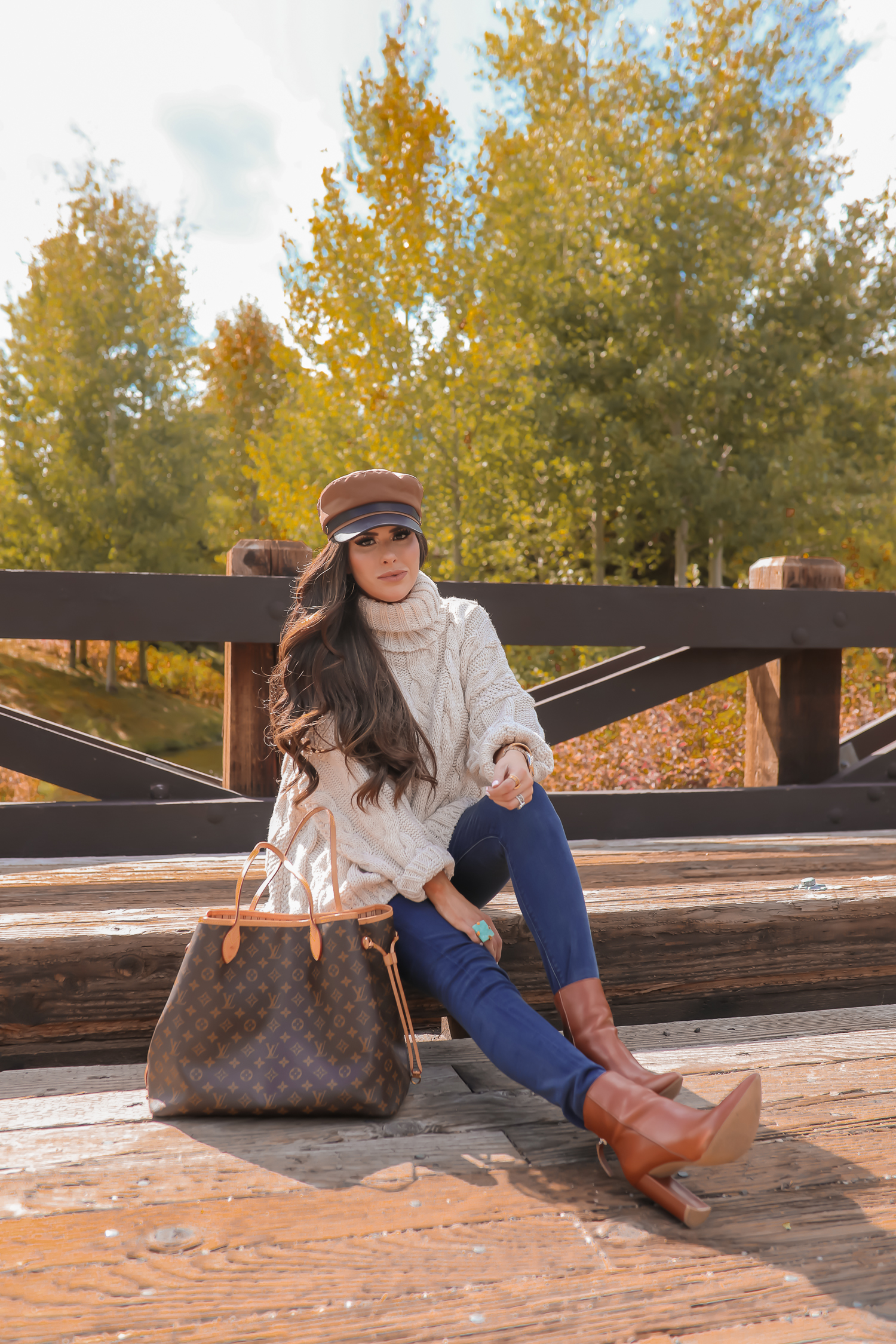 Cable knit sweater styled for Fall by top US fashion blog, The Sweetest Thing: image of a woman wearing a Topshop cable knit sweater, Express jeans, Steve Madden booties, Louis Vuitton handbag and Free People Ring.