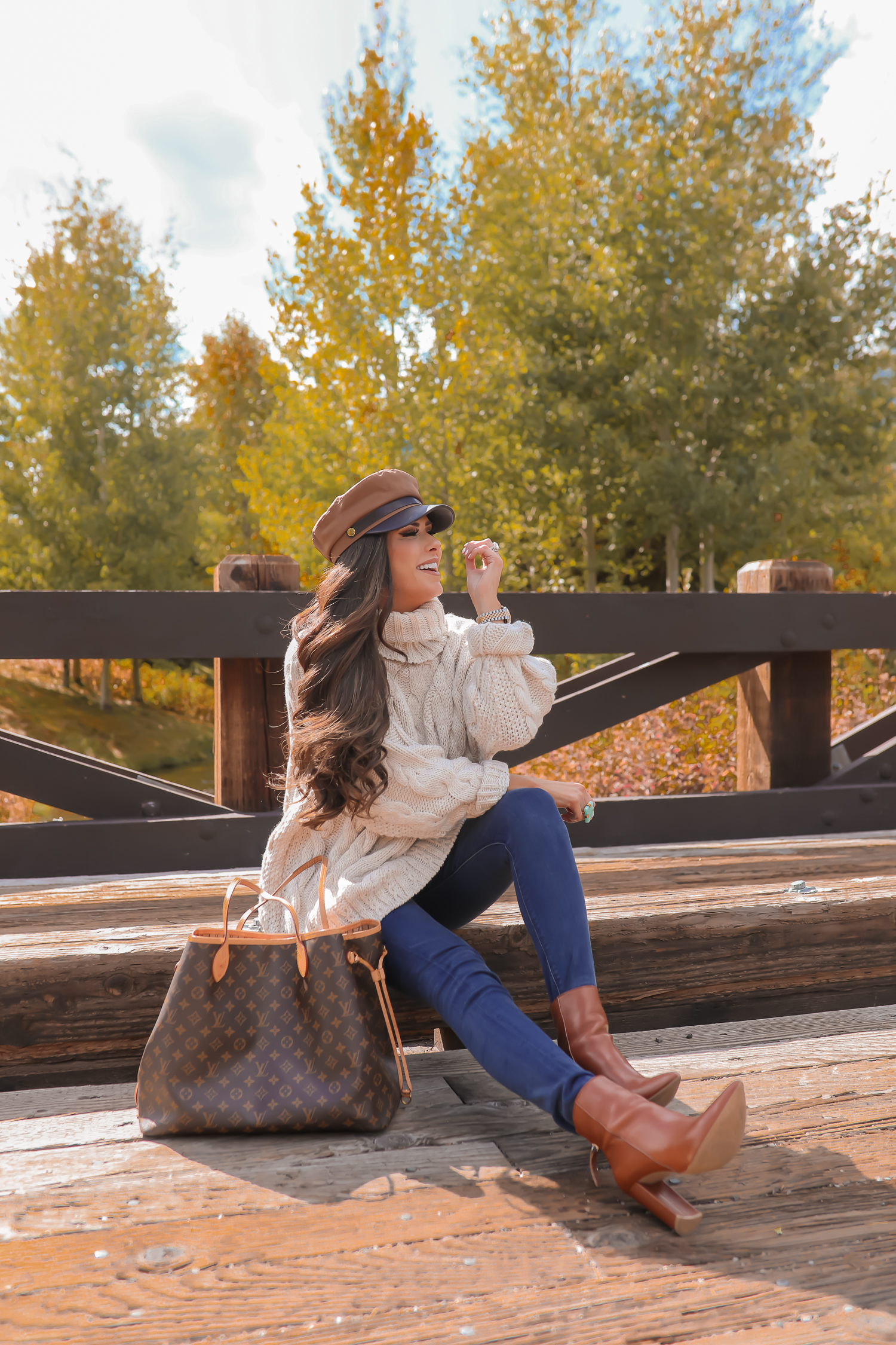 Cable knit sweater styled for Fall by top US fashion blog, The Sweetest Thing: image of a woman wearing a Topshop cable knit sweater, Express jeans, Steve Madden booties, Louis Vuitton handbag and Free People Ring | jackson hole fashion blogger, fall fashion 2019, oversized sweaters topshop nordstorm