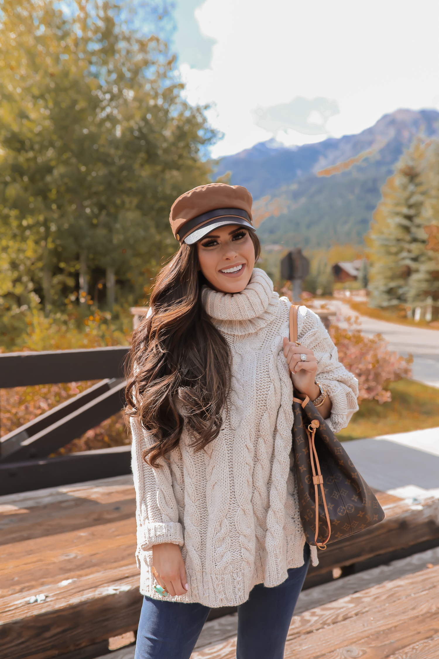 Cable knit sweater styled for Fall by top US fashion blog, The Sweetest Thing: image of a woman wearing a Topshop cable knit sweater, Express jeans, Steve Madden booties, Louis Vuitton handbag and Free People Ring.| fall sweaters and booties pinterest 2019,jackson hole fashion blogger, fall fashion 2019, oversized sweaters topshop nordstorm