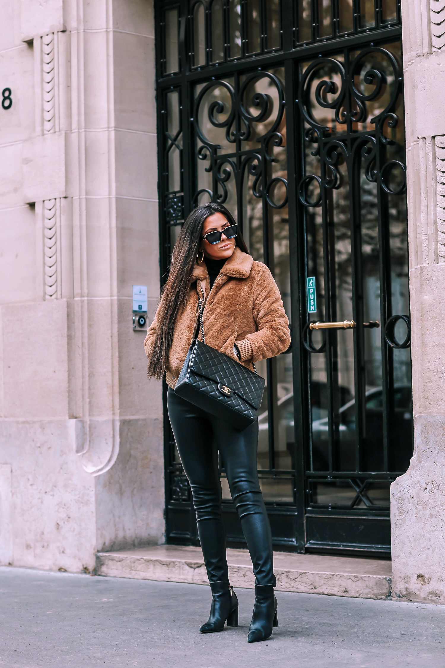 paris fall fashion 2019, fall fashion 2019, banana republic fall outfits 2019, paris outfit ideas fall and winter, what to wear in paris in october november, emily ann gemma-2 | Do You Like Neon Or Neutrals?! Two Everyday Fall Outfits by popular Oklahoma fashion blog, The Sweetest Thing: image of a woman outside in Paris and wearing a Banana Republic Faux Fur Bomber, Banana Republic Merino-Blend Funnel-Neck Sweater, and Banana Republic High-Rise Skinny Coated Jean.