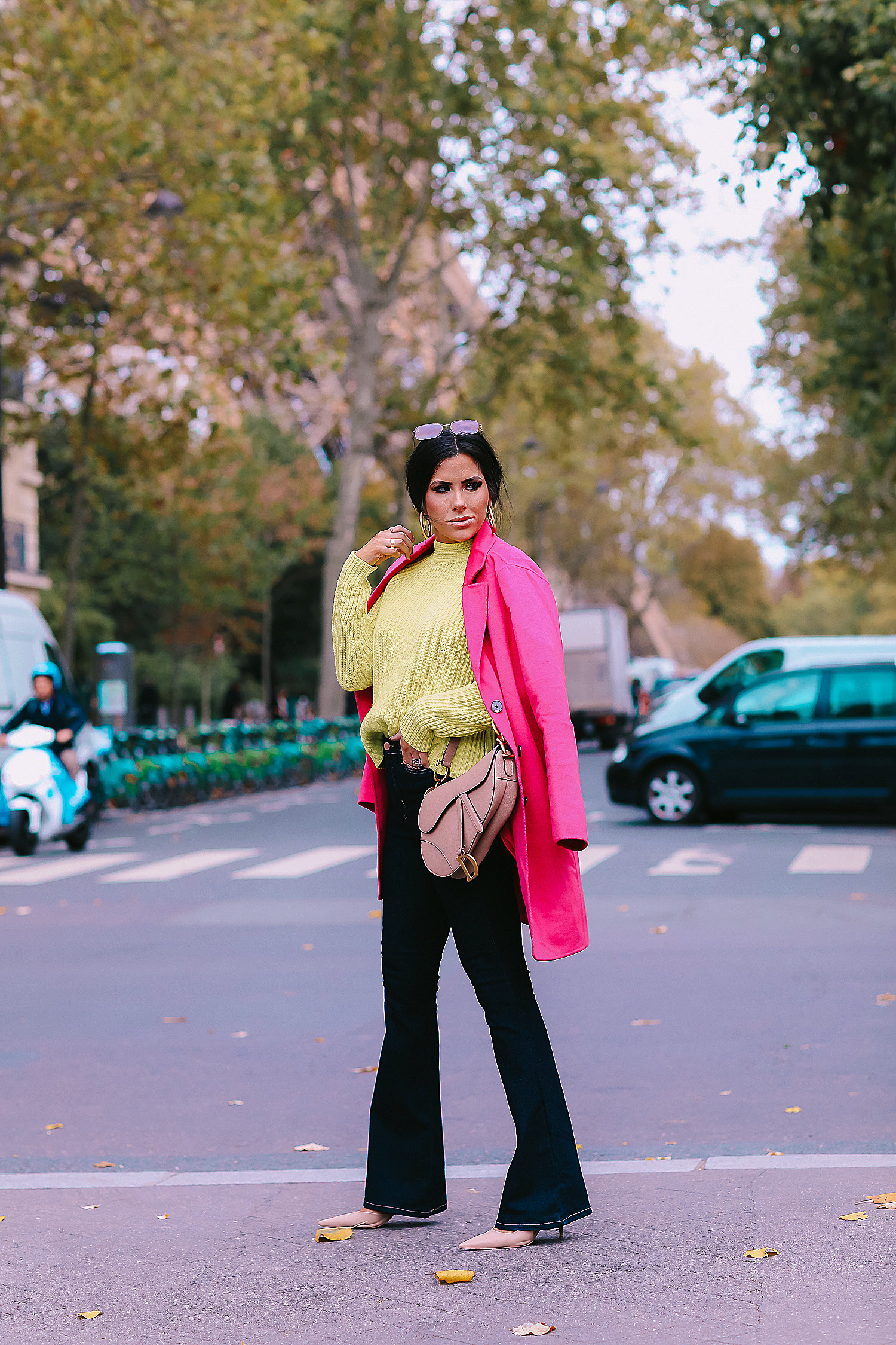 paris fall fashion 2019, fall fashion 2019, banana republic fall outfits 2019, paris outfit ideas fall and winter, what to wear in paris in october november, emily ann gemma-2 | Do You Like Neon Or Neutrals?! Two Everyday Fall Outfits by popular Oklahoma fashion blog, The Sweetest Thing: image of a woman outside in Paris and wearing a Banana Republic High-Rise Flare Jean, Banana Republic Double-Faced Topcoat, and Banana Republic Chunky High Crew-Neck Sweater.