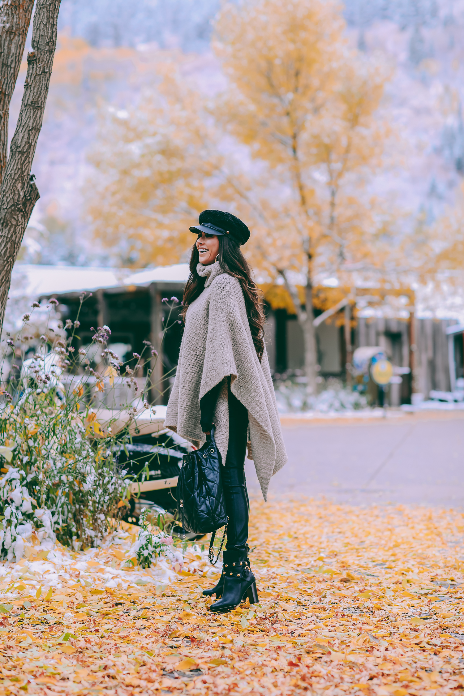 Cute snow day outfits styled by top US fashion blog, The Sweetest Thing: image of a woman wearing a Caslon black top, BlankNYC pants, See by Chloe boots, Leith baker boy cap, and a Chanel backpack | winter 2019 fashion outfits pinterest, mango cape poncho, chanel black quilted backpack, aspen fashion blogger, emily gemma, cute outfits for aspen-2