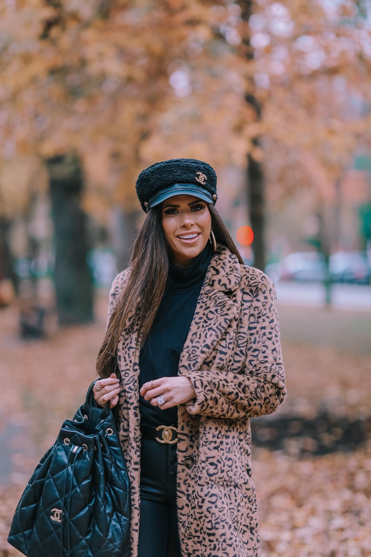 Faux Fur Leopard Coat styled by top US fashion blogger, Emily Gemma of The Sweetest Thing: image of a woman wearing a Mural faux fur leopard coat.