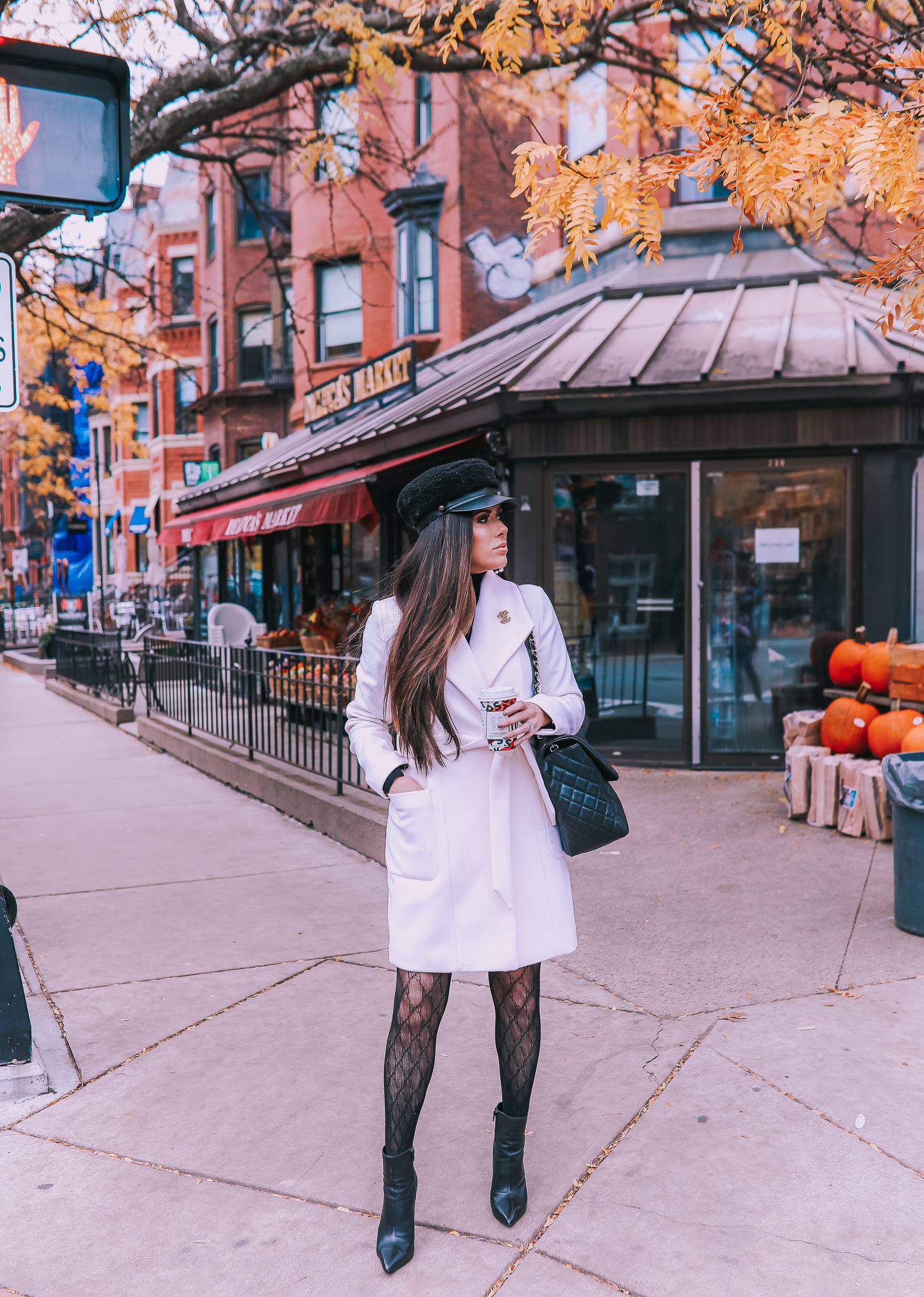 Classic Winter Outfit featured by top US fashion blog, The Sweetest Thing: image of a woman wearing an Express white coat, an Express black turtleneck, an Express tweed skirt, Gucci tights, and a Chanel bag. | fall outfit ideas pinterest 2019, black gucci tights outfit idea, pinterest gucci tight outfit idea, emily ann gemma, express fall fashion 2019, emily ann gemma, Chanel XXL airlines tote black-2