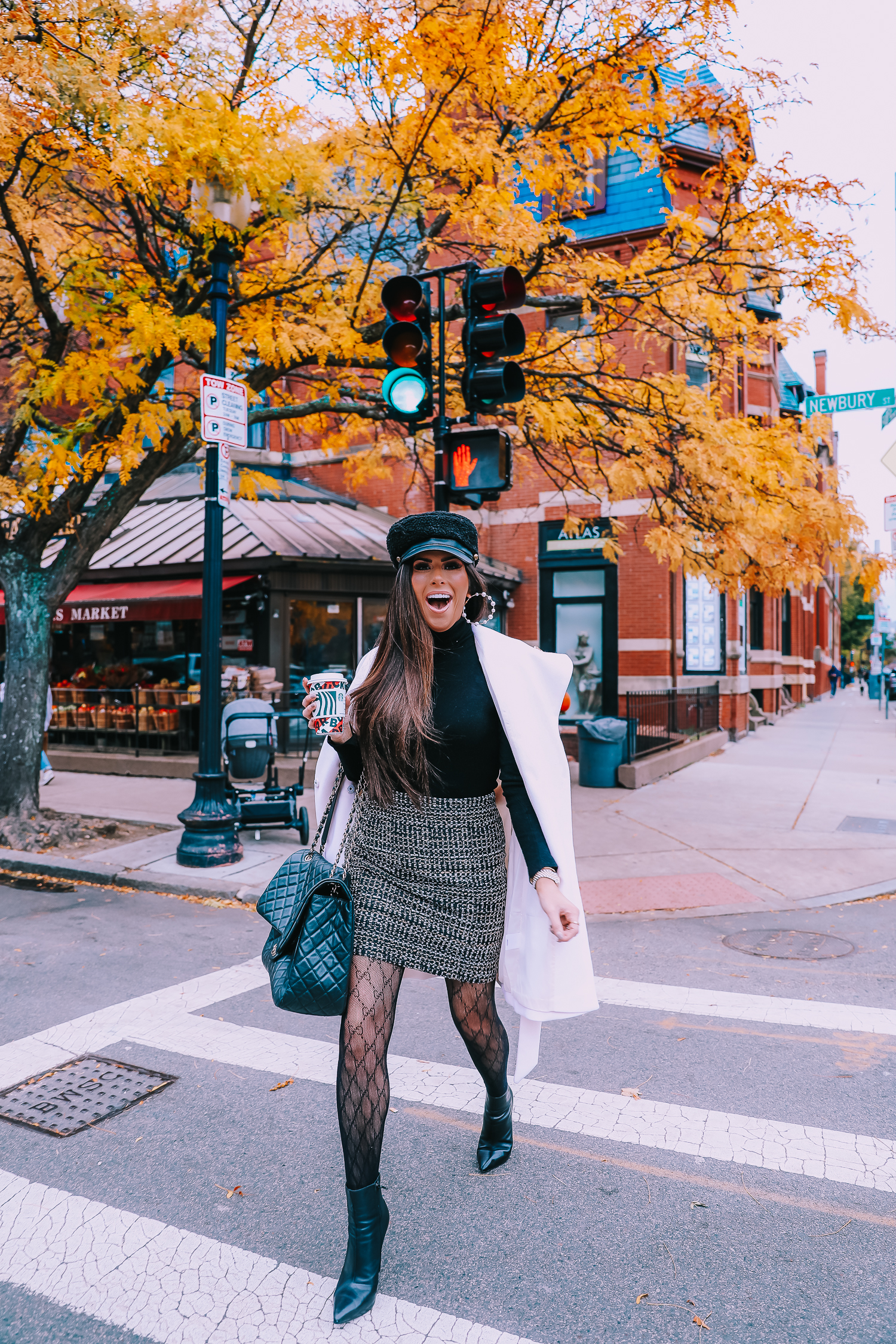 Classic Winter Outfit featured by top US fashion blog, The Sweetest Thing: image of a woman wearing an Express white coat, an Express black turtleneck, an Express tweed skirt, Gucci tights, and a Chanel bag.