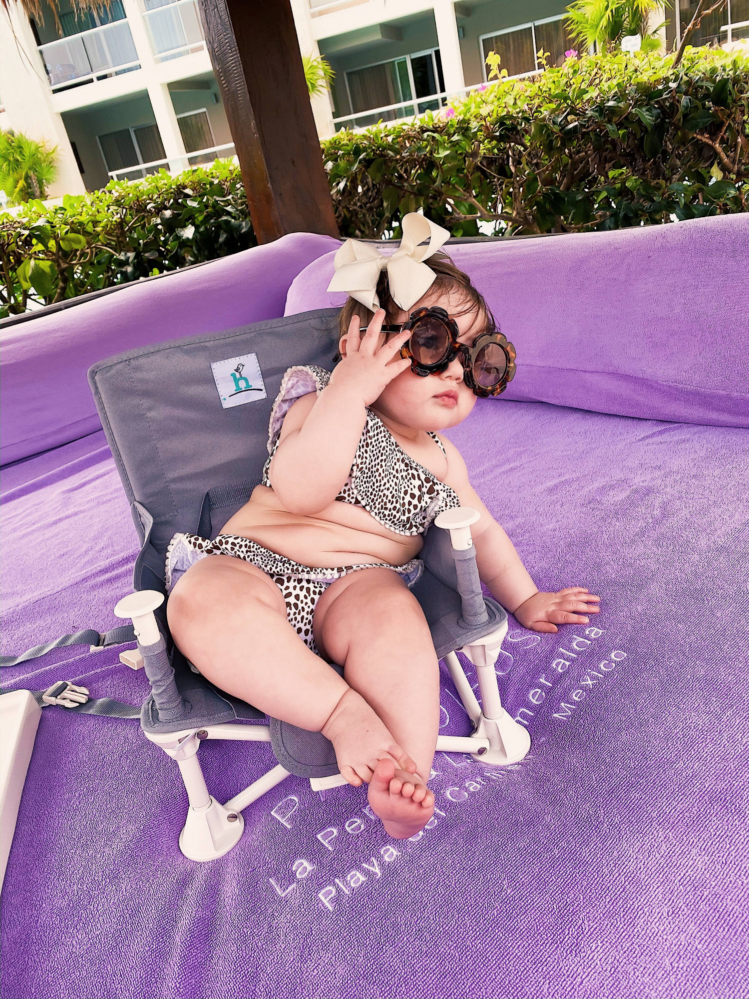 baby fashionista in swimsuit, baby girl in swimsuit, emily gemma | A YEAR IN REVIEW : MASSIVE 2019 INSTAGRAM RECAP by popular Oklahoma life and style blog, The Sweetest Thing: image of a baby sitting outside and wearing a Janie and Jack JUNO VALENTINE CHEETAH 2-PIECE SWIMSUIT and Amazon ADEWU Sunglasses for Kids Round Flower Cute Glasses.