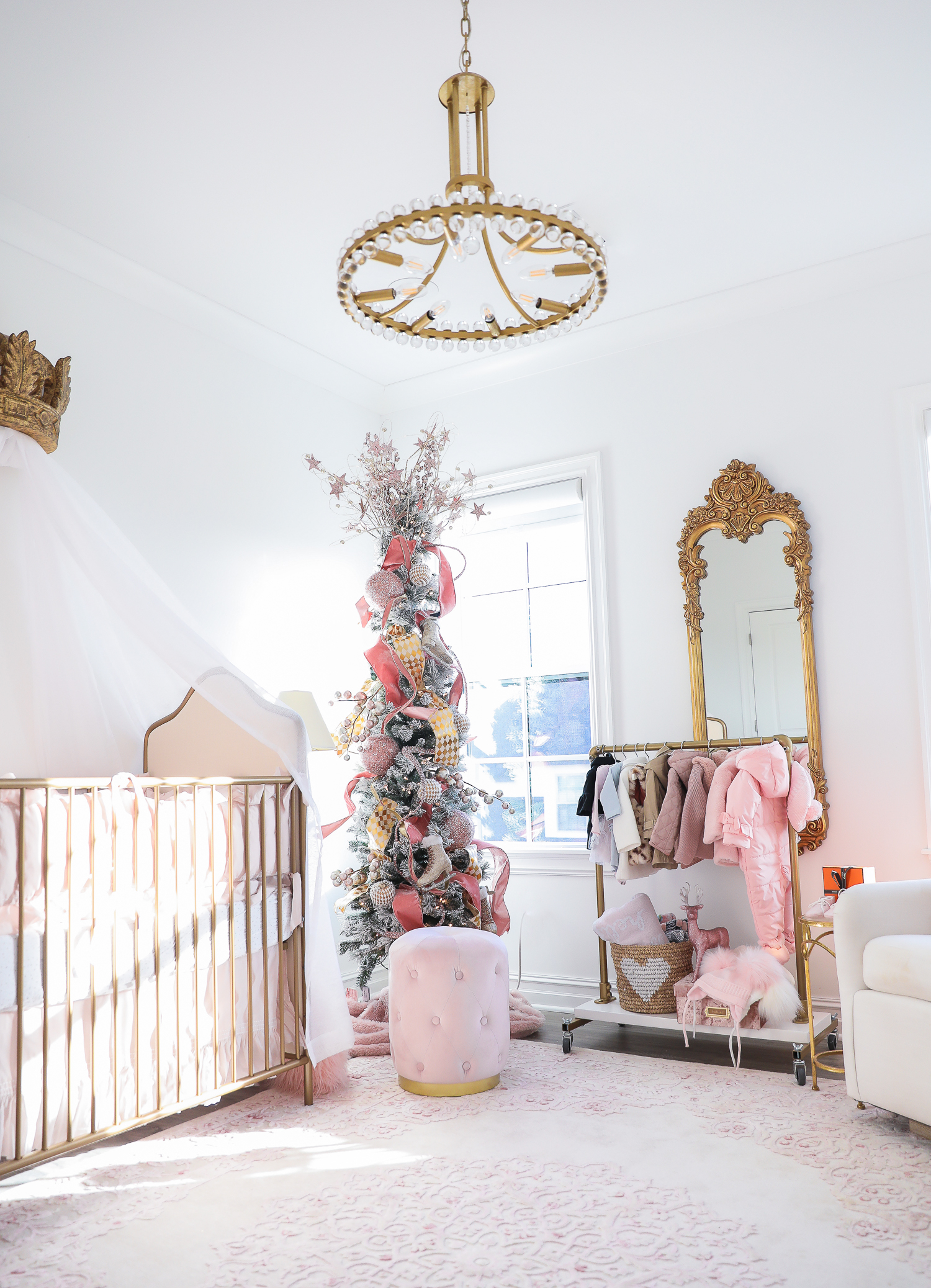 baby girl nursery inspiration christmas pinterest, baby girl nursery christmas tree, emily gemma, gold baby garment rack, the sweetest thing blog-2 |  Sophia's Baby Girl Nursery at Christmastime by popular Oklahoma life and style blog, The Sweetest Thing: image of a girl nursery decorated with a Nordstrom Nolene Sequin Party Dress, Pottery Barn Kids Merced Glider & Ottoman, Wayfair Piper 2-in-1 Convertible Crib, RH Baby & Child NEW RUFFLE APPLIQUÉD ORGANIC VOILE NURSERY BEDDING COLLECTION, Wayfair Fontanne Oriental Pink/White Area Rug, Overstock Clover 8-light Aged Brass Chandelier, Horchow Sophia Rectangular Dressing Mirror, Etsy ShopAndisList Childrens standard rack, Pottery Barn Kids Raffia Heart Baskets, RH Baby & Child GILT DEMILUNE CANOPY BED CROWN, Walmart Holiday Time Pre-Lit Snow-Flocked Colorado Artificial Christmas Tree, 7', White Lights, Target Wondershop Glitter Deer Decorative Figurine Blush, T.J. Maxx pink velvet storage box, Wayfair Arnulfo 6 Drawer Double Dresser, Nordstrom Nursery Essential Gift Set, Nordstrom Sophie la Girafe Teething Toy, Glamboxes GLAMstand Hair Accessory Organizer, Serena & Lily Jenn Thatcher painting, Pottery Barn Kids Luxe Chamois Changing Pad, Crate & Kids Acrylic Shelf Bookcase, RH Baby and Child ANTIQUED GILT WOOD LETTER, Wayfair Luxe Solid Faux Fur Throw Pillow, Gap Toddler Cable-Knit Pom Beanie, Maisonette SteamLine Luggage *Exclusive* Vanity Case, Smocked Auctions NUTCRACKER SMOCKED BISHOP PINK GINGHAM, Nordstrom Ugg Jesse Bow Fluff Bootie, Overstock Safavieh Couture Carnation Round Tufted Ottoman, Pottery Barn Kids Blush Velvet Nursery Storage, and Nordstrom Chenille Blanket.