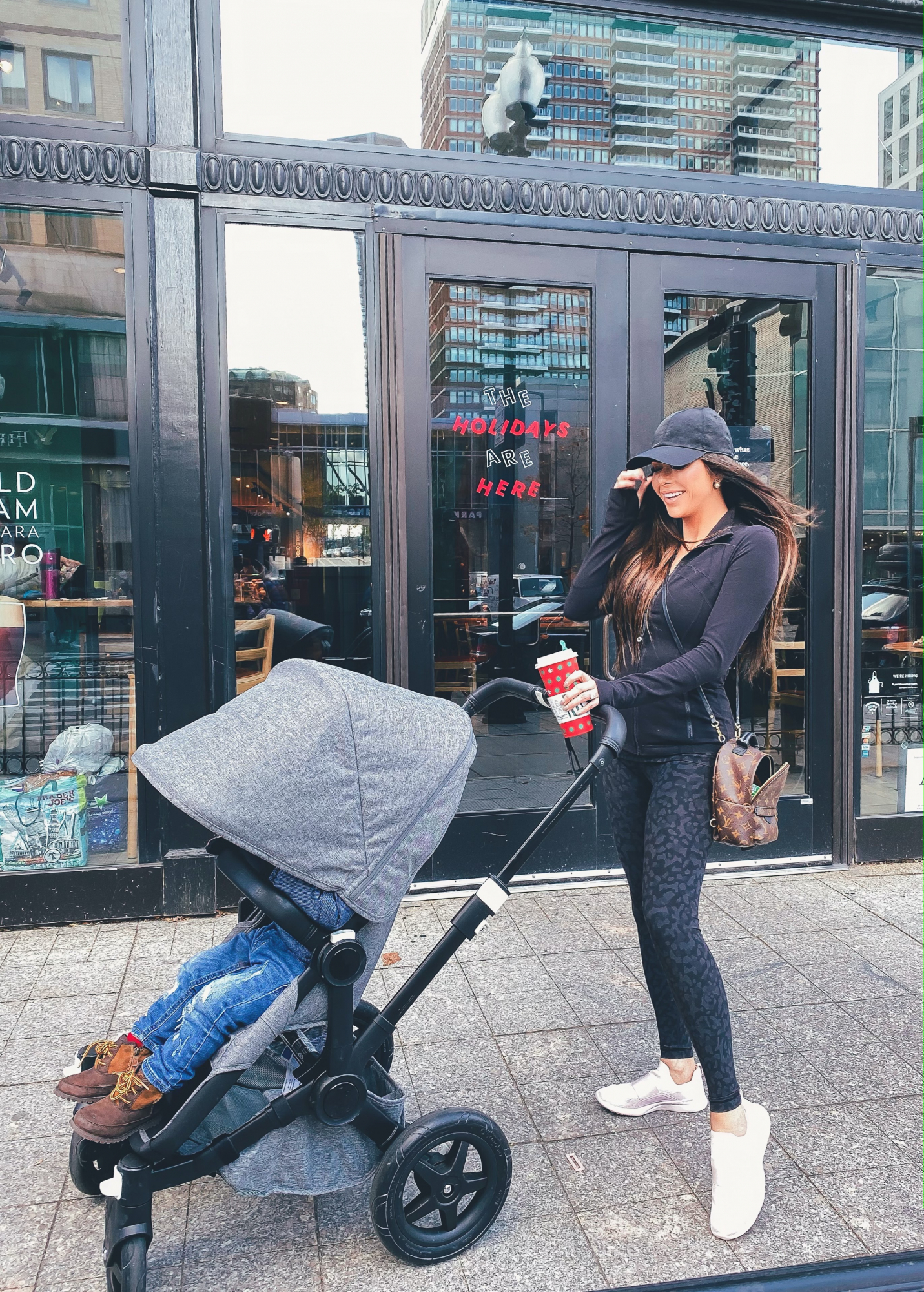 boston 2019 winter, luluelmon outfit | A YEAR IN REVIEW : MASSIVE 2019 INSTAGRAM RECAP by popular Oklahoma life and style blog, The Sweetest Thing: image of a woman pushing a Nordstrom Donkey2 Classic Mono Complete Stroller with Bassinet BUGABOO and wearing a Lululemon Baller Hat Run, ShopBop APL: Athletic Propulsion Labs TechLoom Bliss Sneakers, Lululemon Define Jacket, and holding a Louis Vuitton mini backpack.