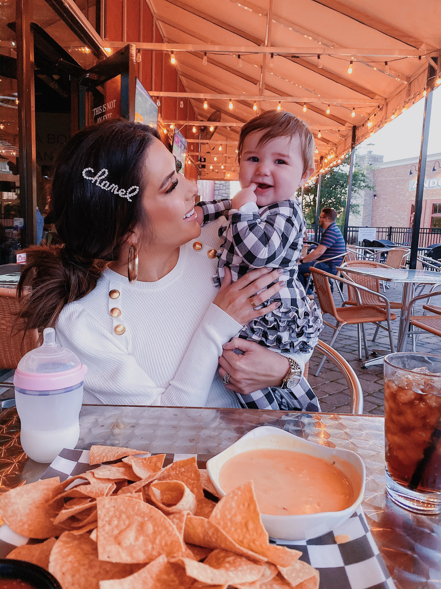 chanel hair clip cursive, emily gemma, tulsa fashion blogger | A YEAR IN REVIEW : MASSIVE 2019 INSTAGRAM RECAP by popular Oklahoma life and style blog, The Sweetest Thing: image of a mom holding her baby and wearing a Zara sweater.