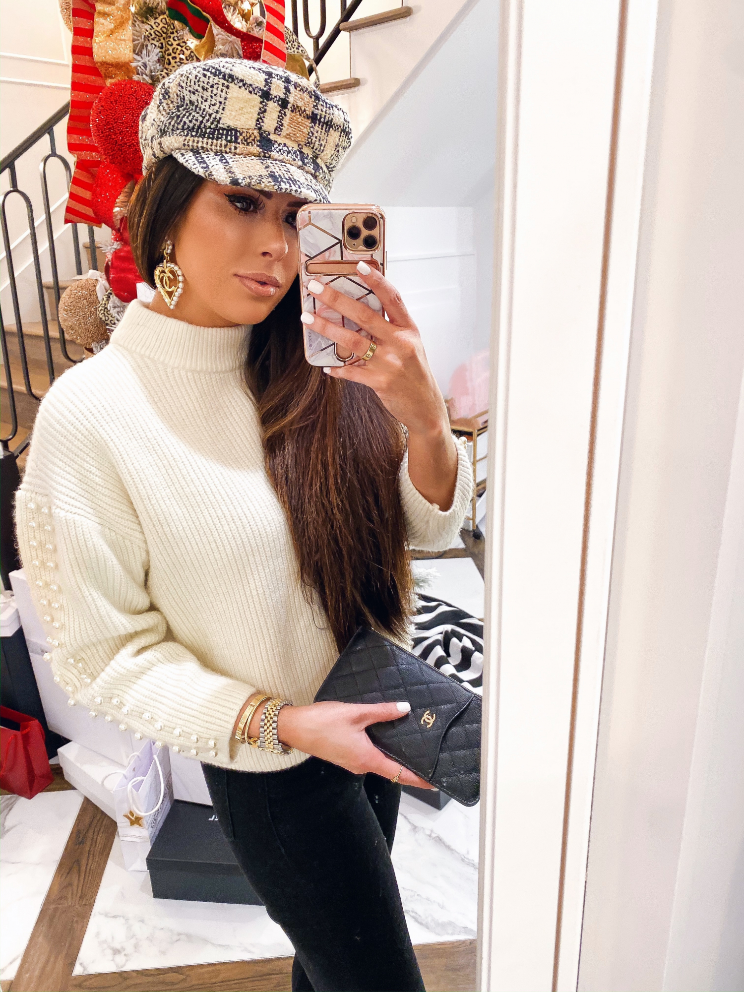 chanel pearl heart earrings, cream sweater pearls on sleeves, chanel phone wallet case | A YEAR IN REVIEW : MASSIVE 2019 INSTAGRAM RECAP by popular Oklahoma life and style blog, The Sweetest Thing: image of a woman wearing a H&M tweed baker hat and H&M Sweater with Pearlescent Beads.