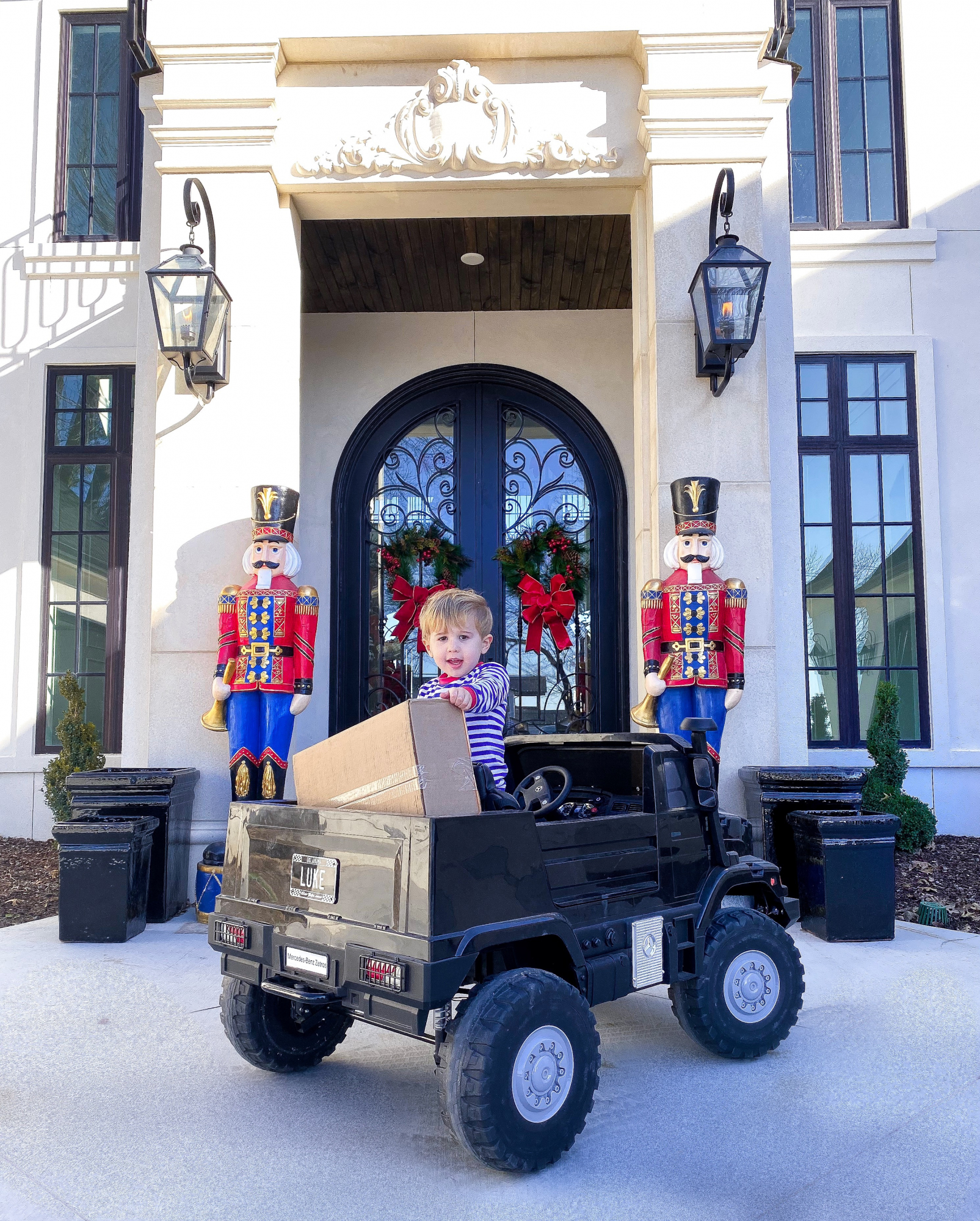 christmas front door decor pinterest 2019 nutcrackers, kids remote mercedes trucks, emily gemma | A YEAR IN REVIEW : MASSIVE 2019 INSTAGRAM RECAP by popular Oklahoma life and style blog, The Sweetest Thing: image of a little boy wearing Smocked auctions pajamas.