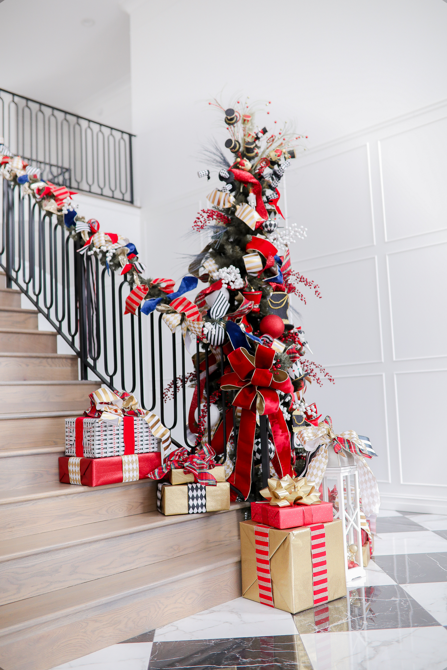 christmas tree inspiration, pinterest christmas tree inspiration 2019, gift ideas gift guide 2019, wayf lace top, chanel black gold belt, best christmas tree home decor, black loubtouin booties-2 | FAVORITE GIFT IDEAS FOR HER + MEGA GIVEAWAY [+Louis Vuitton Wallet] by popular Oklahoma life and style blog, The Sweetest Thing: image of a pile of presents on a staircase.