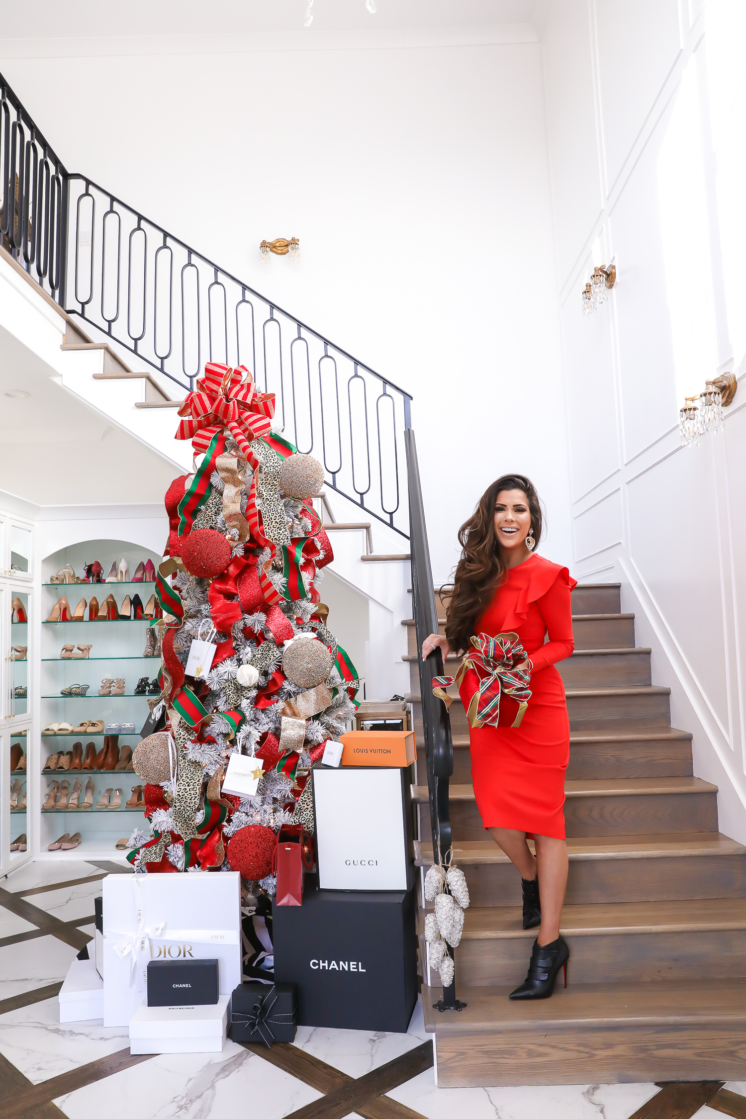 christmas tree inspiration, two story closet, designer christmas tree, giorgio armani review, emily gemma, pinterest christmas decor 2019-2 | The Perfect Rachel Parcell Dress & A New Makeup Review by popular Oklahoma fashion blog, The Sweetest Thing: image of a woman standing on a staircase next to a Christmas tree and wearing a Nordstrom Rachel Parcell Ruffle Long Sleeve Ponte Dress, Nordstrom Christian LouBoutin Triniboot Stiletto Bootie, Nordstrom Charlotte Tilbury Lip Cheat Lip Liner, Nordstrom Charlotte Tilbury Hot Lips Lipstick, and Nordstrom Tom Ford Gloss Luxe Moisturizing Lipgloss.