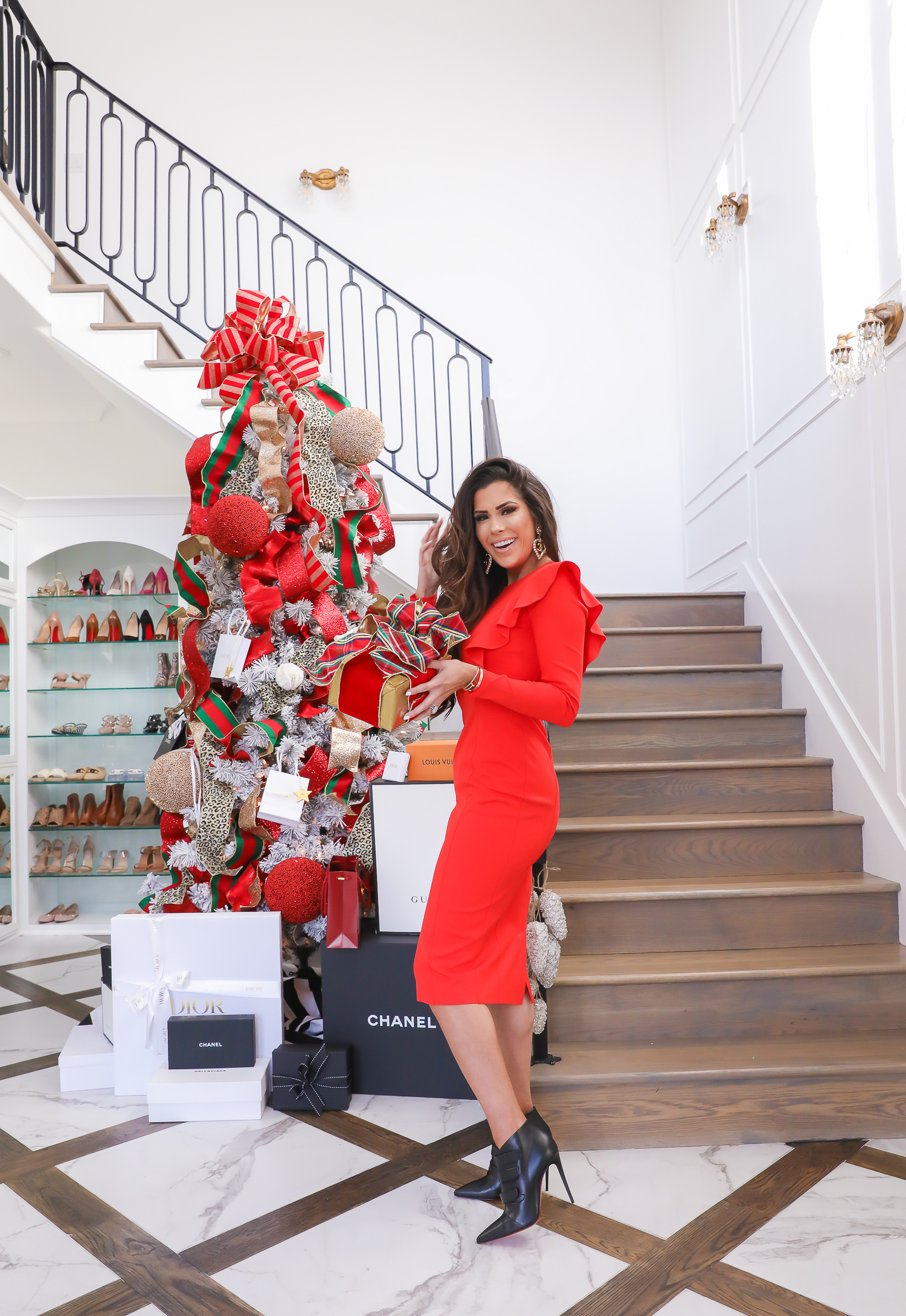 christmas tree inspiration, two story closet, designer christmas tree, giorgio armani review, emily gemma, pinterest christmas decor 2019-2 | The Perfect Rachel Parcell Dress & A New Makeup Review by popular Oklahoma fashion blog, The Sweetest Thing: image of a woman standing on a staircase next to Christmas tree and wearing a Nordstrom Rachel Parcell Ruffle Long Sleeve Ponte Dress, Nordstrom Christian LouBoutin Triniboot Stiletto Bootie, Nordstrom Charlotte Tilbury Lip Cheat Lip Liner, Nordstrom Charlotte Tilbury Hot Lips Lipstick, and Nordstrom Tom Ford Gloss Luxe Moisturizing Lipgloss.