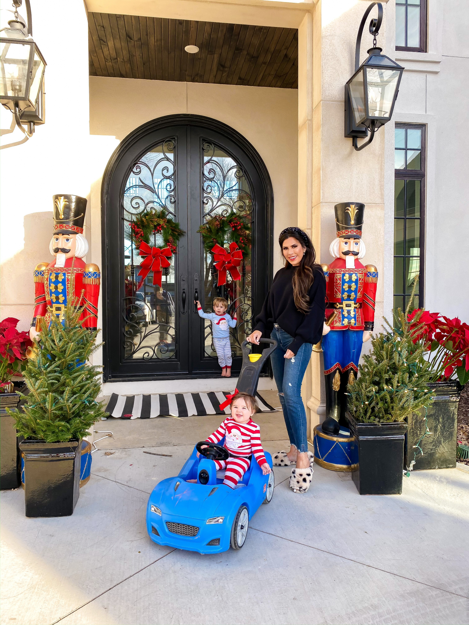 life-size nutcrackers front door, cute front door christmas deocr |A YEAR IN REVIEW : MASSIVE 2019 INSTAGRAM RECAP by popular Oklahoma life and style blog, The Sweetest Thing: image of woman playing outside with her kids and wearing a Revolve Easy Street Tunic Free People brand:Free People, Express Animal Print Faux Fur Slippers, Revolve Mason High-Rise Skinny Jean Lovers + Friends brand: Lovers + Friends, and Revolve Glammed Up Headband.