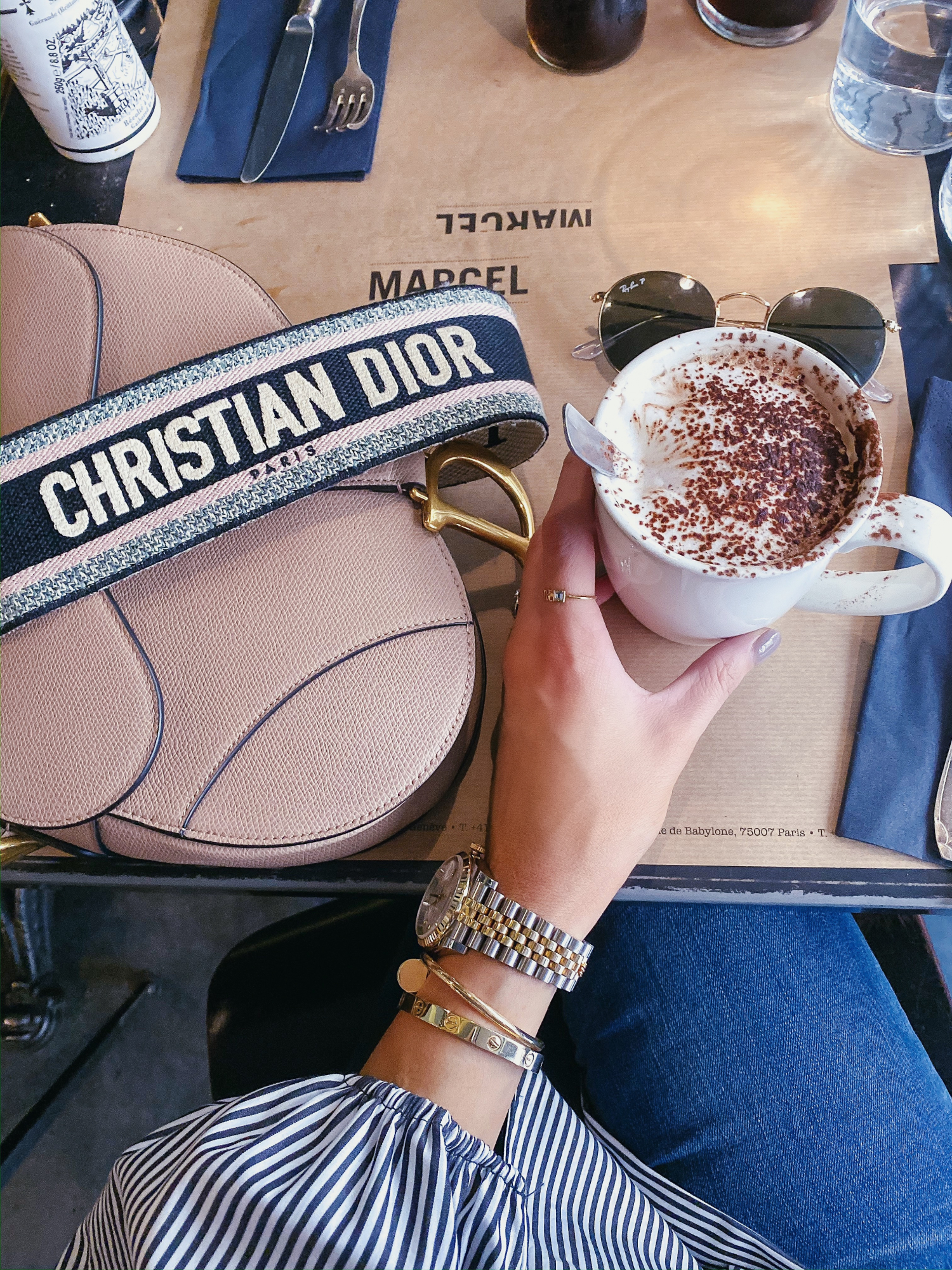 dior saddle bag with strap, emily gemma | A YEAR IN REVIEW : MASSIVE 2019 INSTAGRAM RECAP by popular Oklahoma life and style blog, The Sweetest Thing: image of a Dior saddle bag in nude.