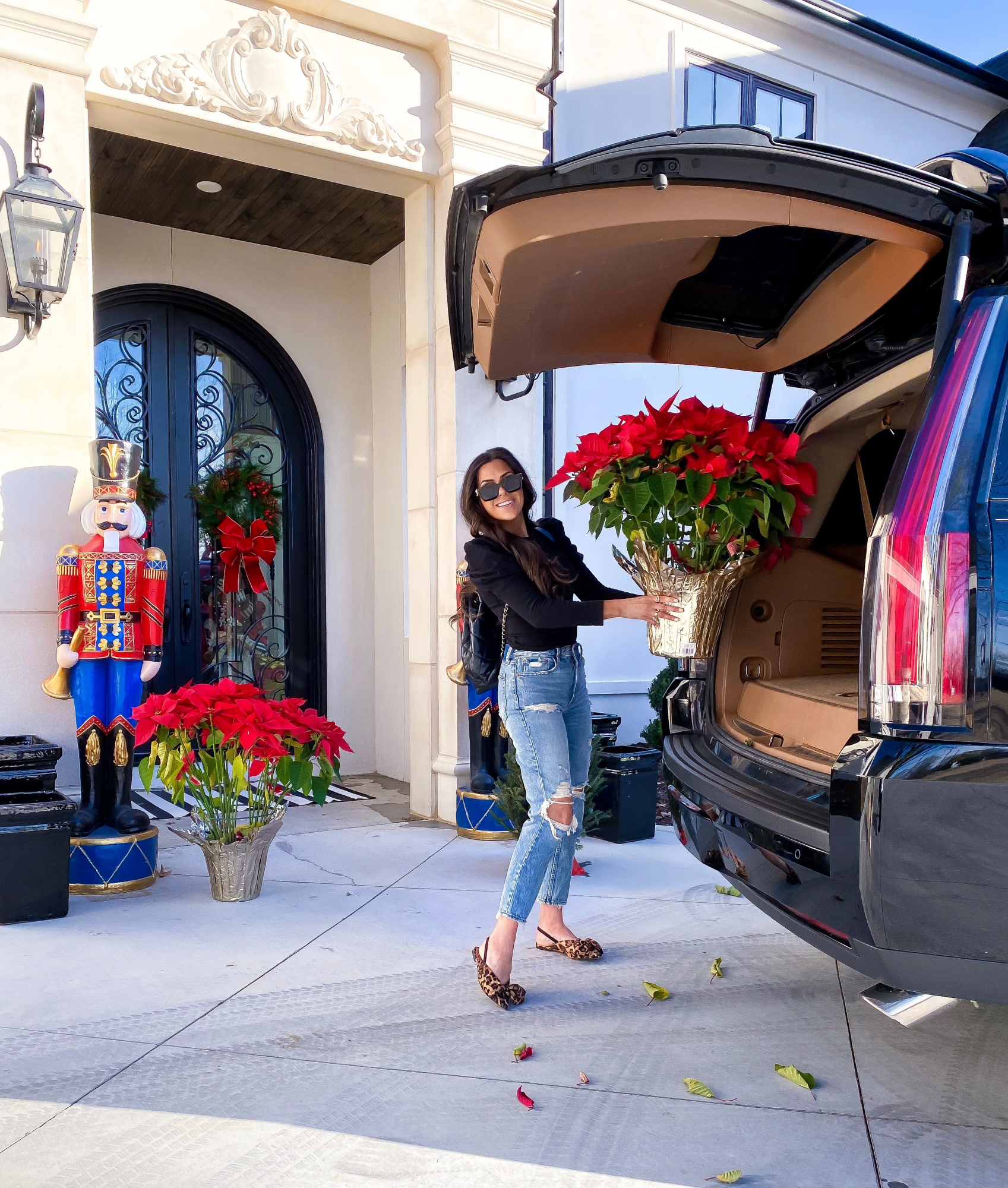 emily gemma, the sweetest thing blog, nutcrackers front door christmas | A YEAR IN REVIEW : MASSIVE 2019 INSTAGRAM RECAP by popular Oklahoma life and style blog, The Sweetest Thing: image of a woman holding a large poinsettia arrangement and wearing a Nordstrom ONE CLOTHING Puff Shoulder Crop Tee, Main, color, 001 Puff Shoulder Crop Tee ONE CLOTHING.