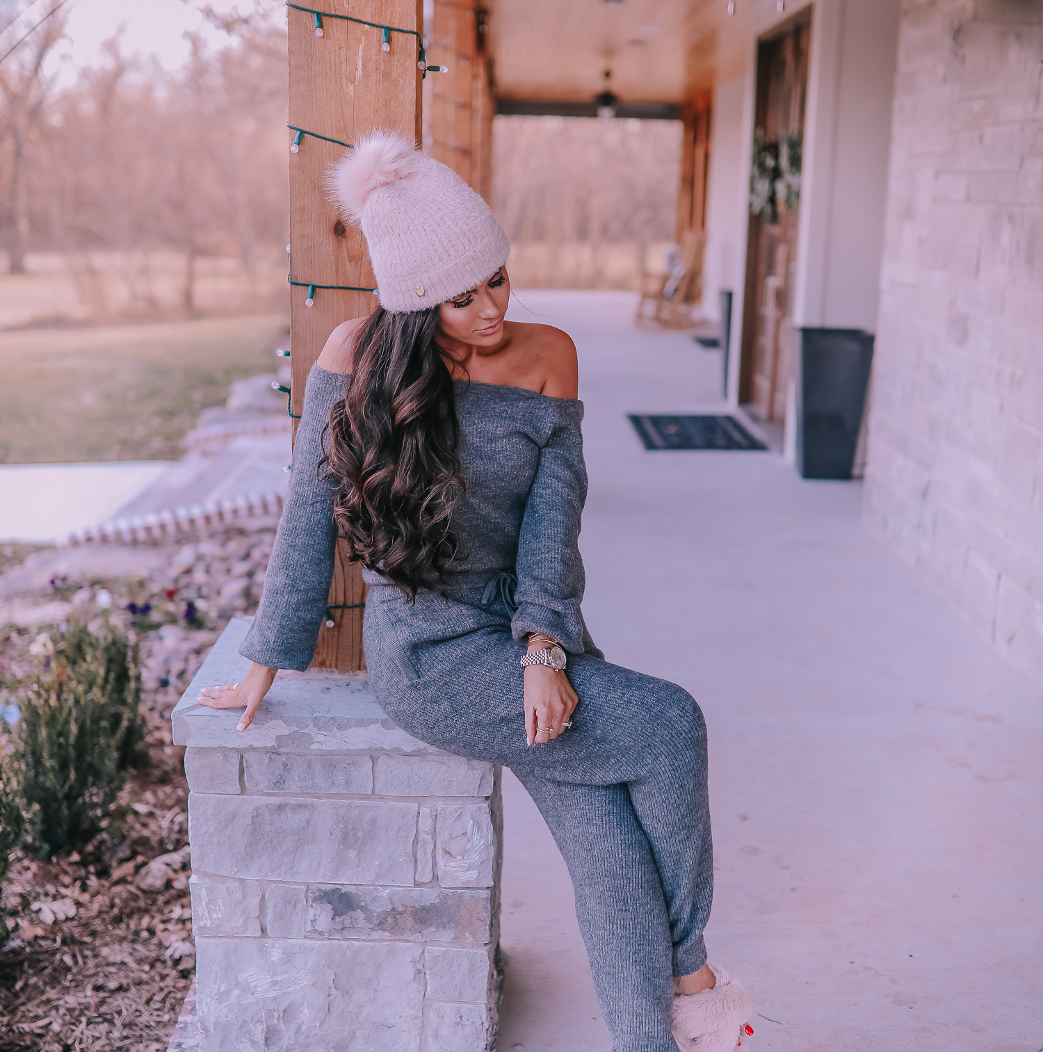 The Perfect Cozy Holiday Outfit [50% Off!] by popular Oklahoma fashion blog, The Sweetest Thing: image of a woman wearing an Express High Waisted Cozy Sweater Jogger Pant, Express Cozy Cropped Ribbed Sweater, Express Metallic Cable Knit Pom Beanie, and Express Criss-Cross Gem Embellished Faux Fur Slippers.