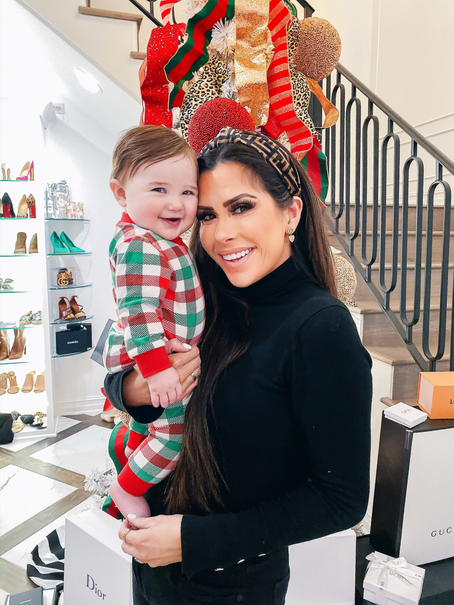 fendi headband, smocked auction christmas pajamas, emily gemma | A YEAR IN REVIEW : MASSIVE 2019 INSTAGRAM RECAP by popular Oklahoma life and style blog, The Sweetest Thing: image of a woman holding her baby and wearing an H&M Fine-knit Turtleneck Sweater and Amazon Fendi Dupe headband.