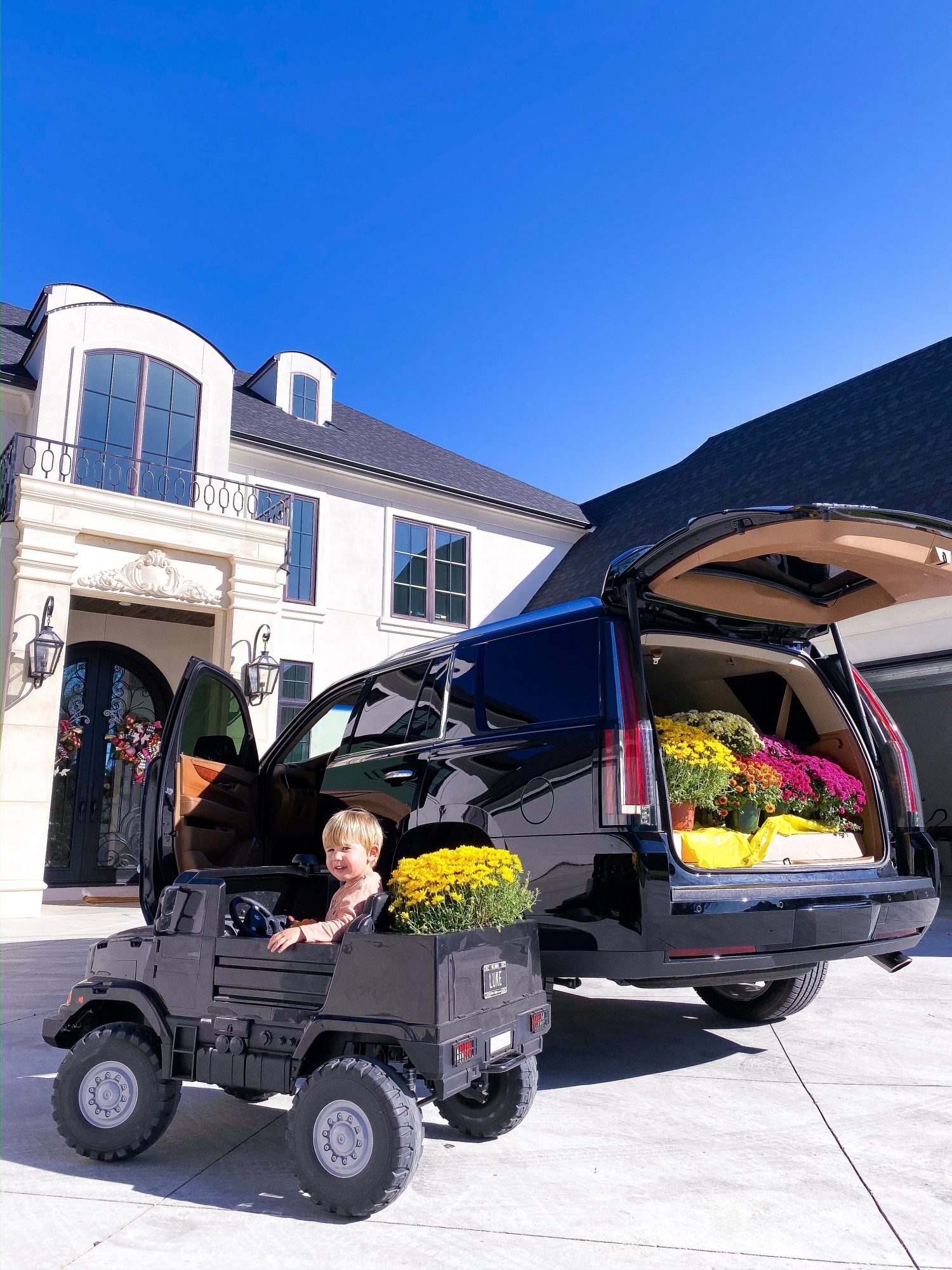 kids mercedes benz remote two seater truck, fall front door decor, emily gemma | A YEAR IN REVIEW : MASSIVE 2019 INSTAGRAM RECAP by popular Oklahoma life and style blog, The Sweetest Thing: image of a little boy riding in a Mercedes Zetros 24 Volt Remote Control Ride On 2 Seat Truck.