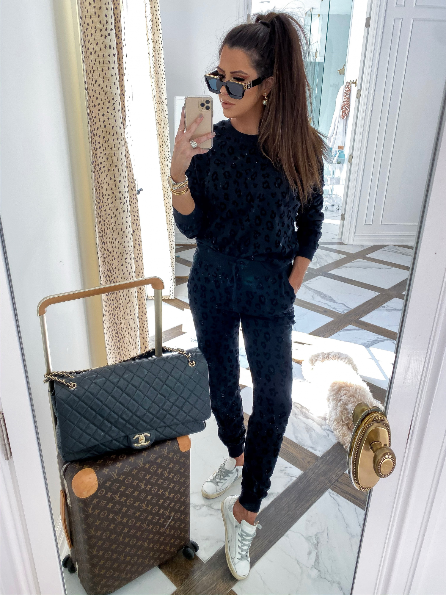 cute travel outfit, z supply leopard outfit, Chanel XXL travel bag, louis vuitton Horizon carryon, Louis vuitton 1.1 millionaire sunglasses | A YEAR IN REVIEW : MASSIVE 2019 INSTAGRAM RECAP by popular Oklahoma life and style blog, The Sweetest Thing: image of a woman taking a selfie and wearing Shopbop Z Supply The Animal Flocked Pullover, Shopbop Z Supply The Animal Flocked Joggers, CHANEL Calfskin Quilted XXL Travel Flap Bag Black, and GOLDEN GOOSE Superstar Low-Top Sneakers.