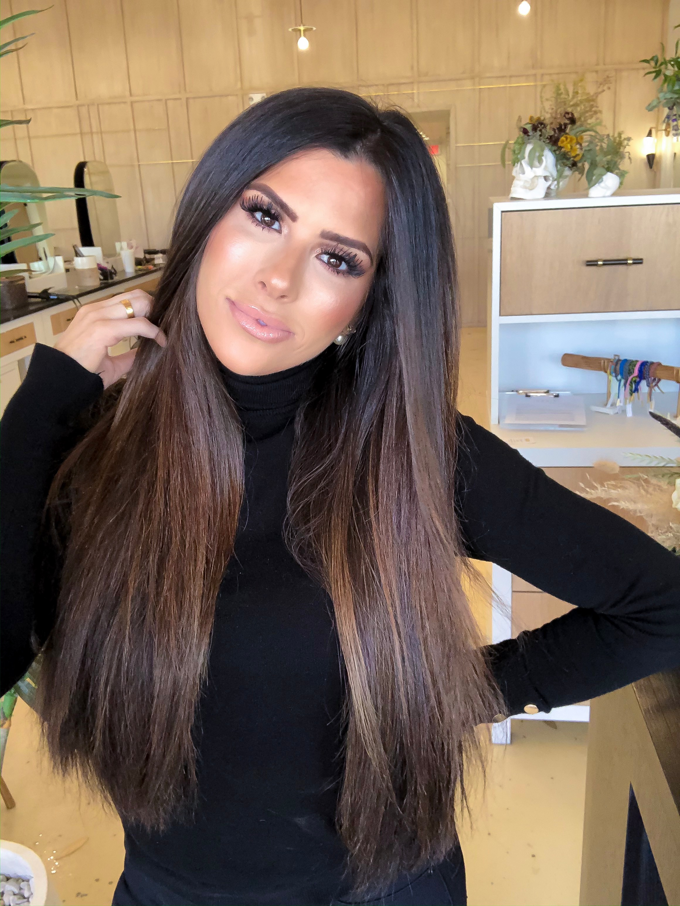 emily gemma hair extensions, straight hair brunette balayage, hair by chrissy |  BEST HAIR PRODUCTS FOR 2019💁🏻‍♀️ || PART 1 by popular US beauty blog, The Sweetest Thing: image of a woman with brunette hair extensions.