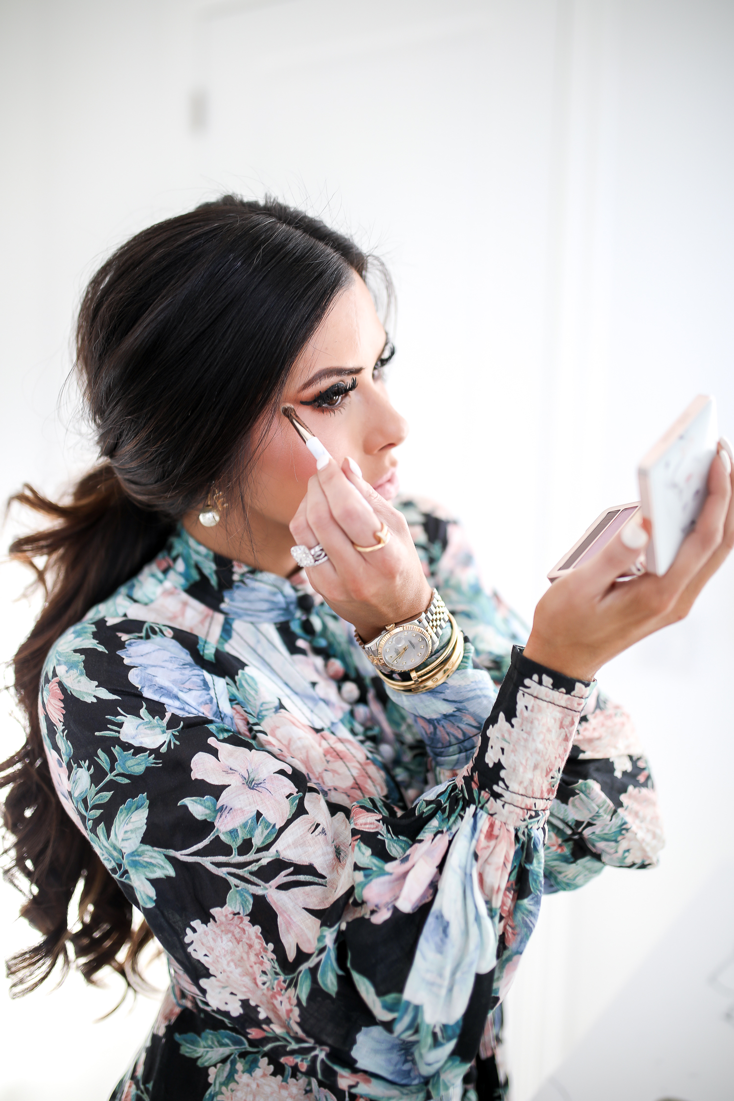 Estee Lauder Makeup by popular US beauty blog, The Sweetest Thing: image of a woman applying Estee Lauder Act IV makeup.